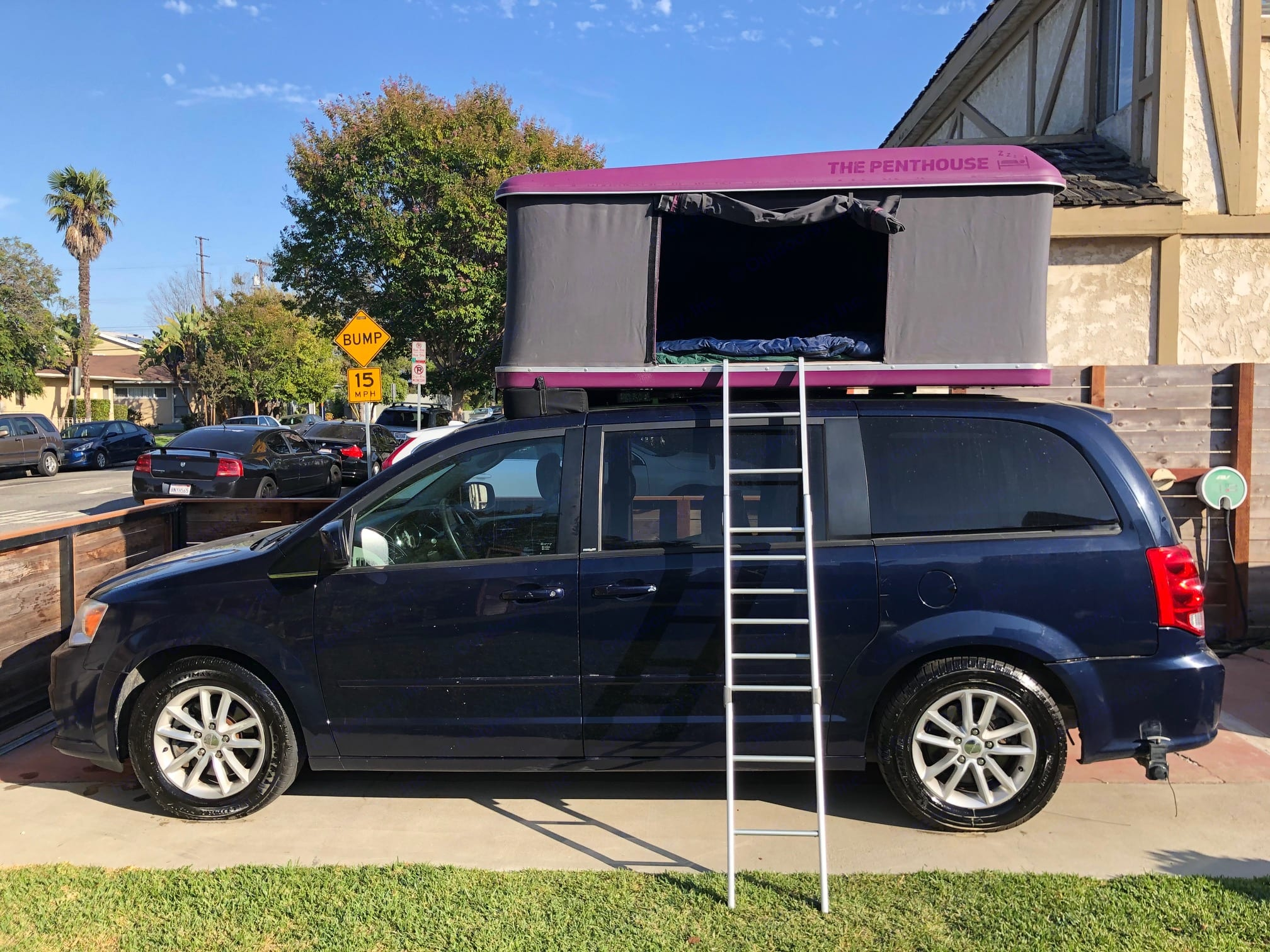 Side view of Camper X van with pop up tent up and ladder down. Dodge Other 2013