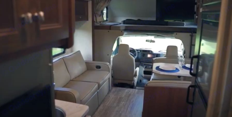 Reclining sofa, convertible dining, and queen bunk. Forest River Forester 2020