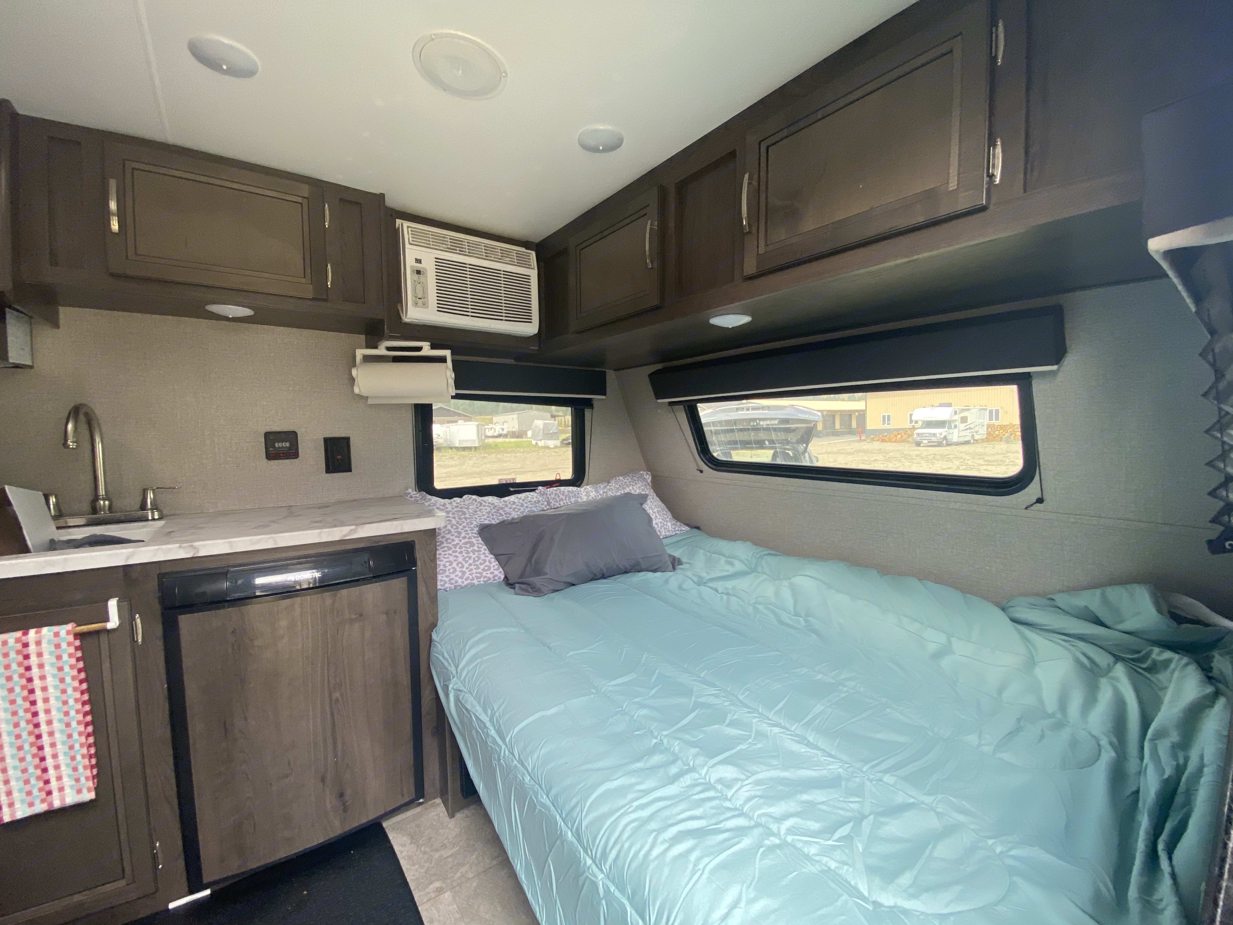 Dining table converts into a queen size bed.. Jayco Baja 2020
