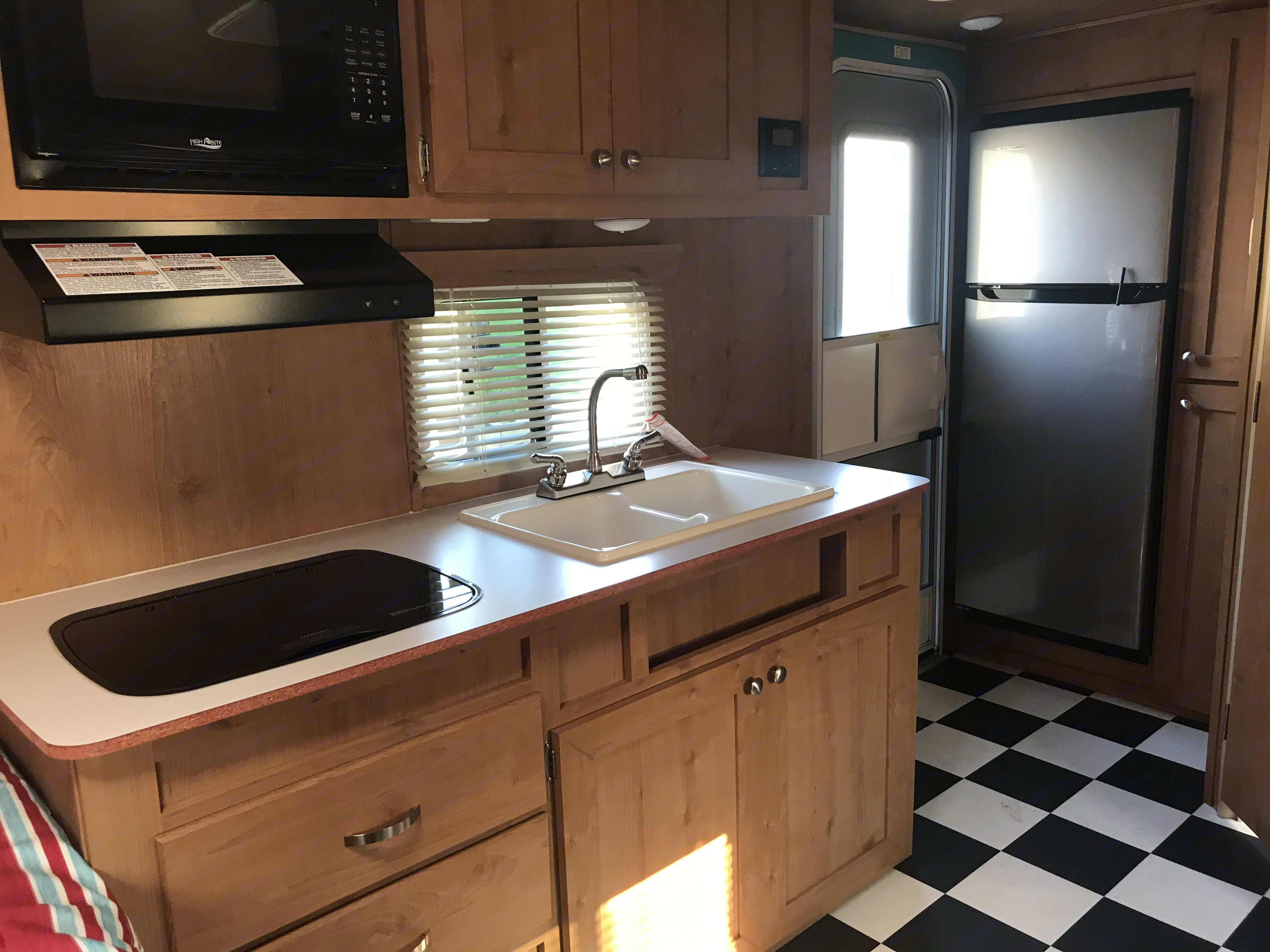 Kitchen area with front door. Riverside Rv Retro 2020