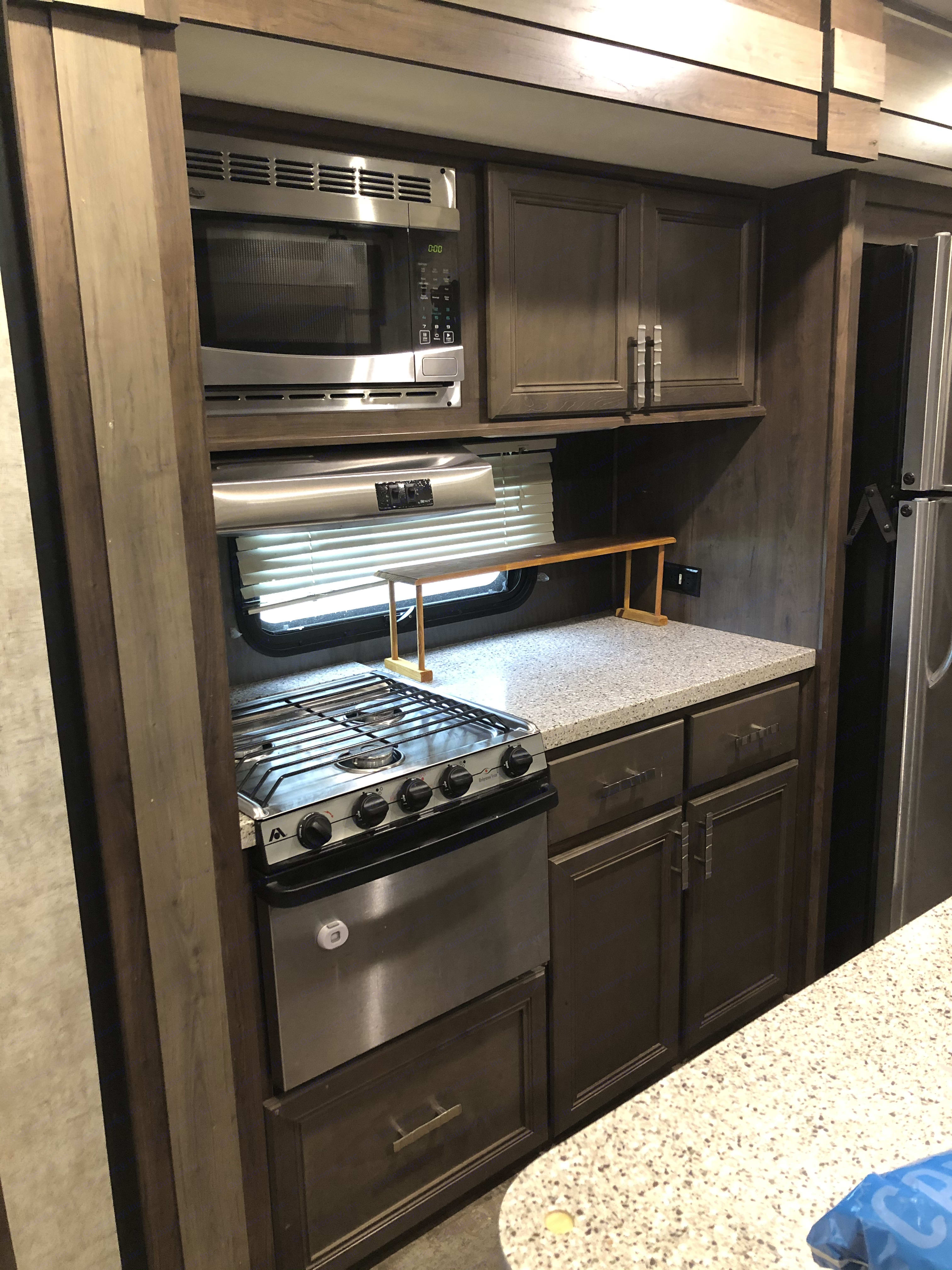 Kitchen area - stove with counter space!. Open Range Roamer 2017