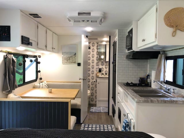 Well equipped kitchen, full refrigerator, dining booth turns into twin bed. Coleman Light LX 1705rb 2019
