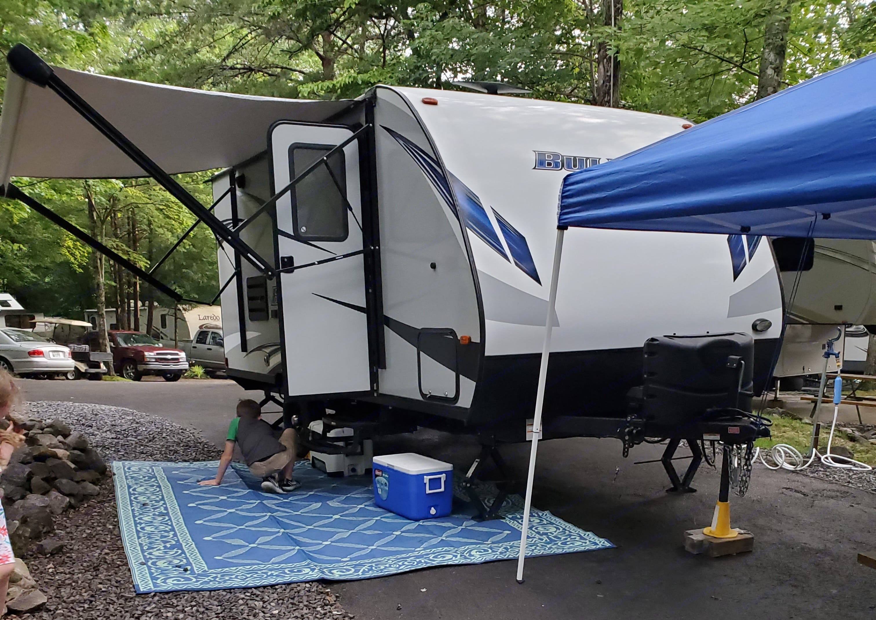 Camper setup with awning extended.. Keystone Bullet 2019