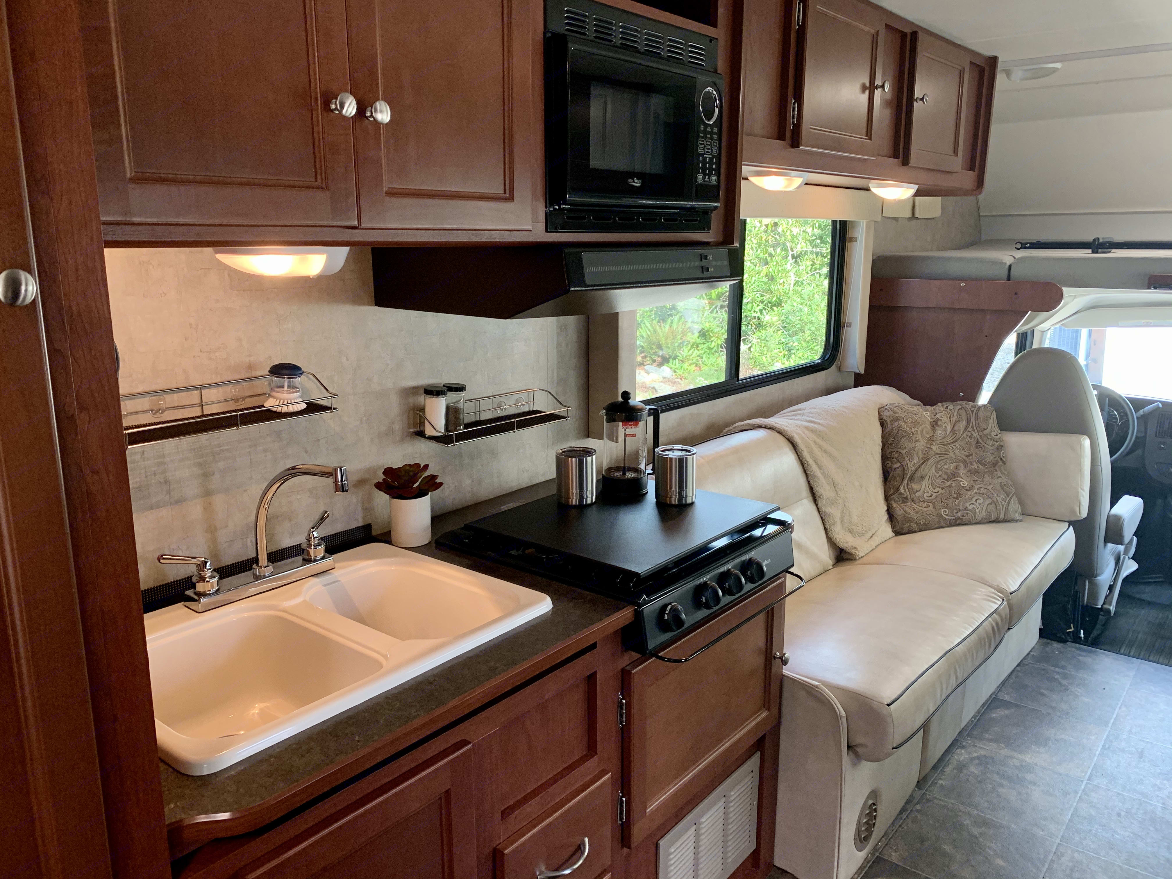 Kitchen - the stove has a cover to create more counter top space. Winnebago Minnie Winnie 2014