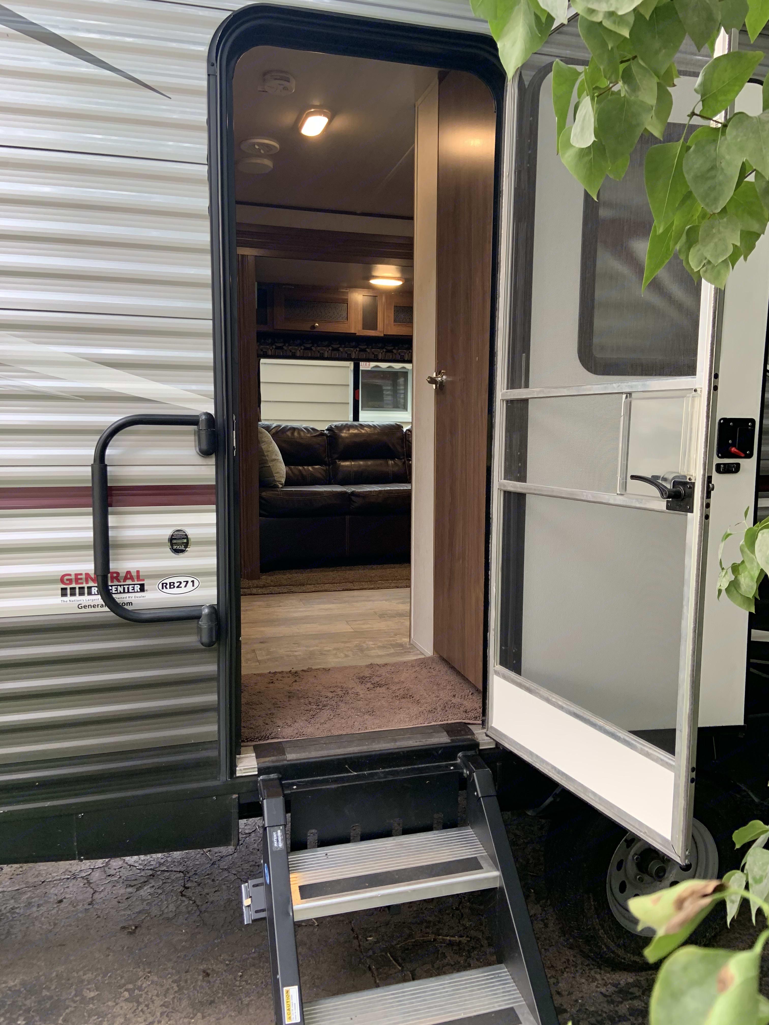 Entrance, screen door detaches from full door. Heartland Pioneer 2019