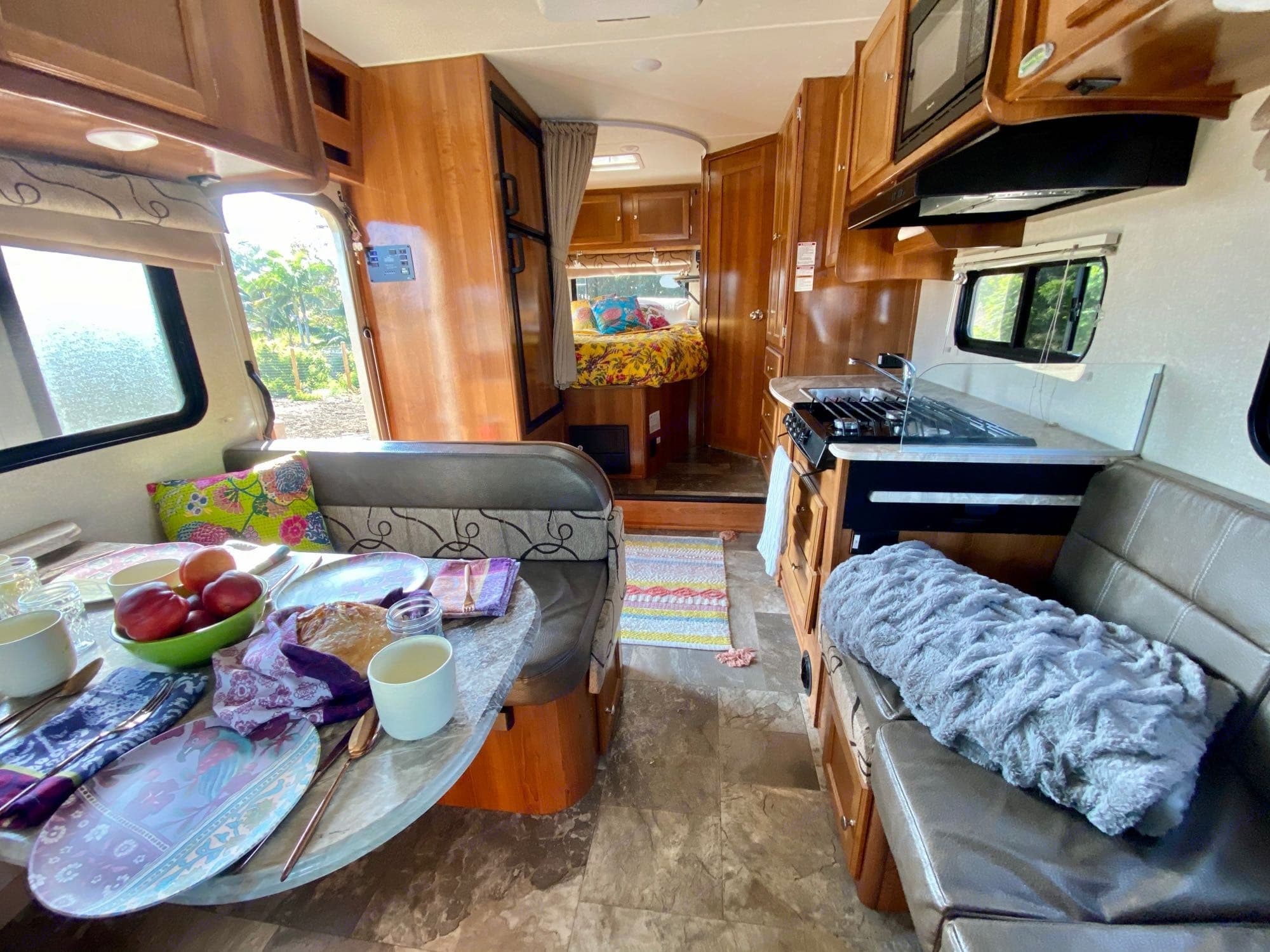 Dining table (left) turns into a bed, couch (right) turns into a table. Coachmen Leprechaun 2019
