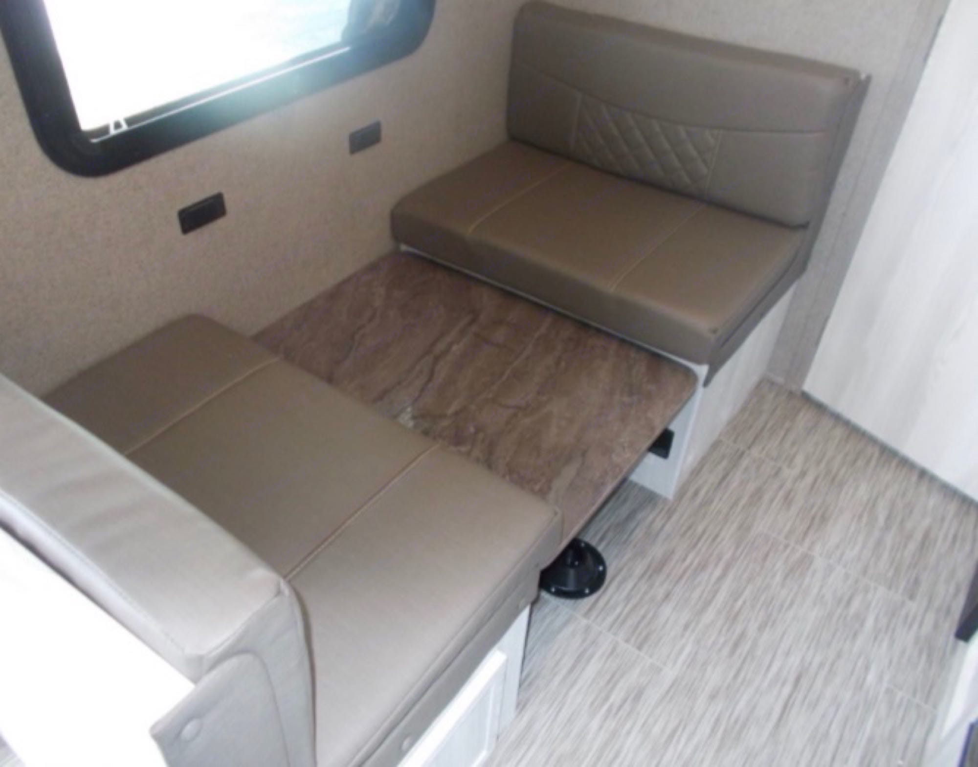 Dinette converts to a single bed. Forest River Rockwood 2021