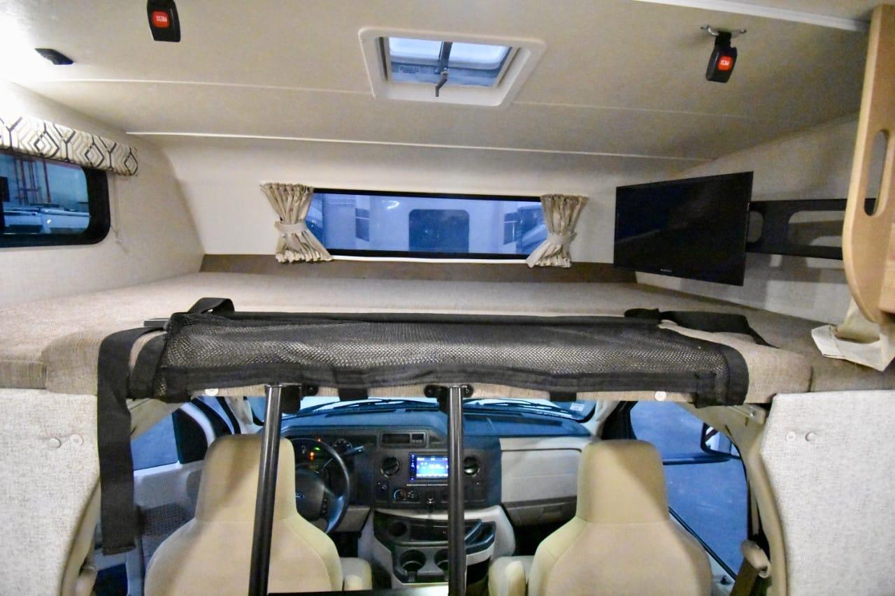 Large overhead bunk that sleeps at least two. Coachmen Leprechaun 2020