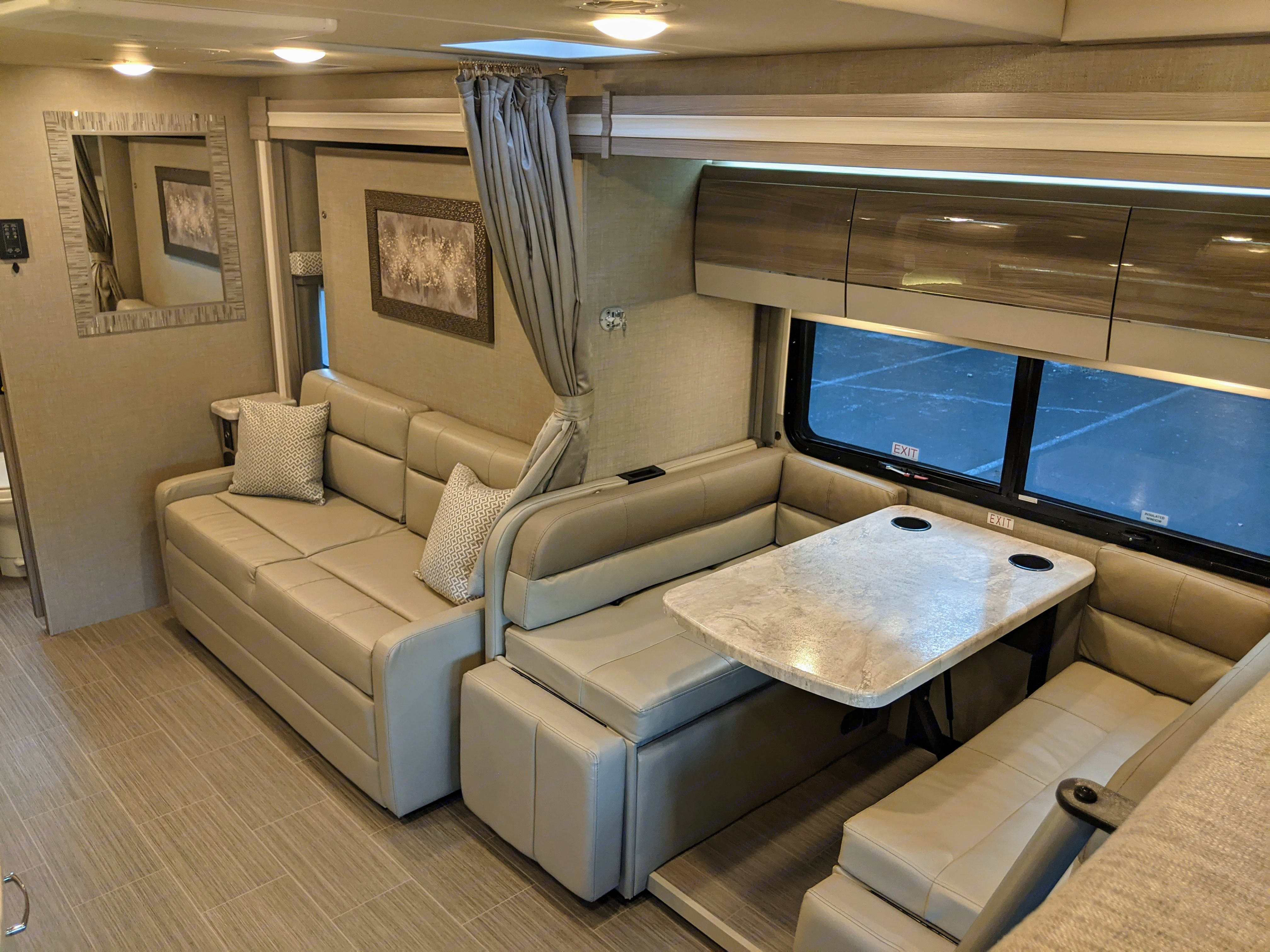 Dinette and sofa. Thor Motor Coach Tiburon 2021