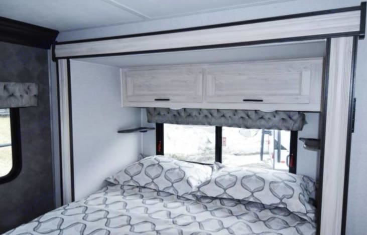 Queen-sized bed with Slide. Forest River Sunseeker 2021