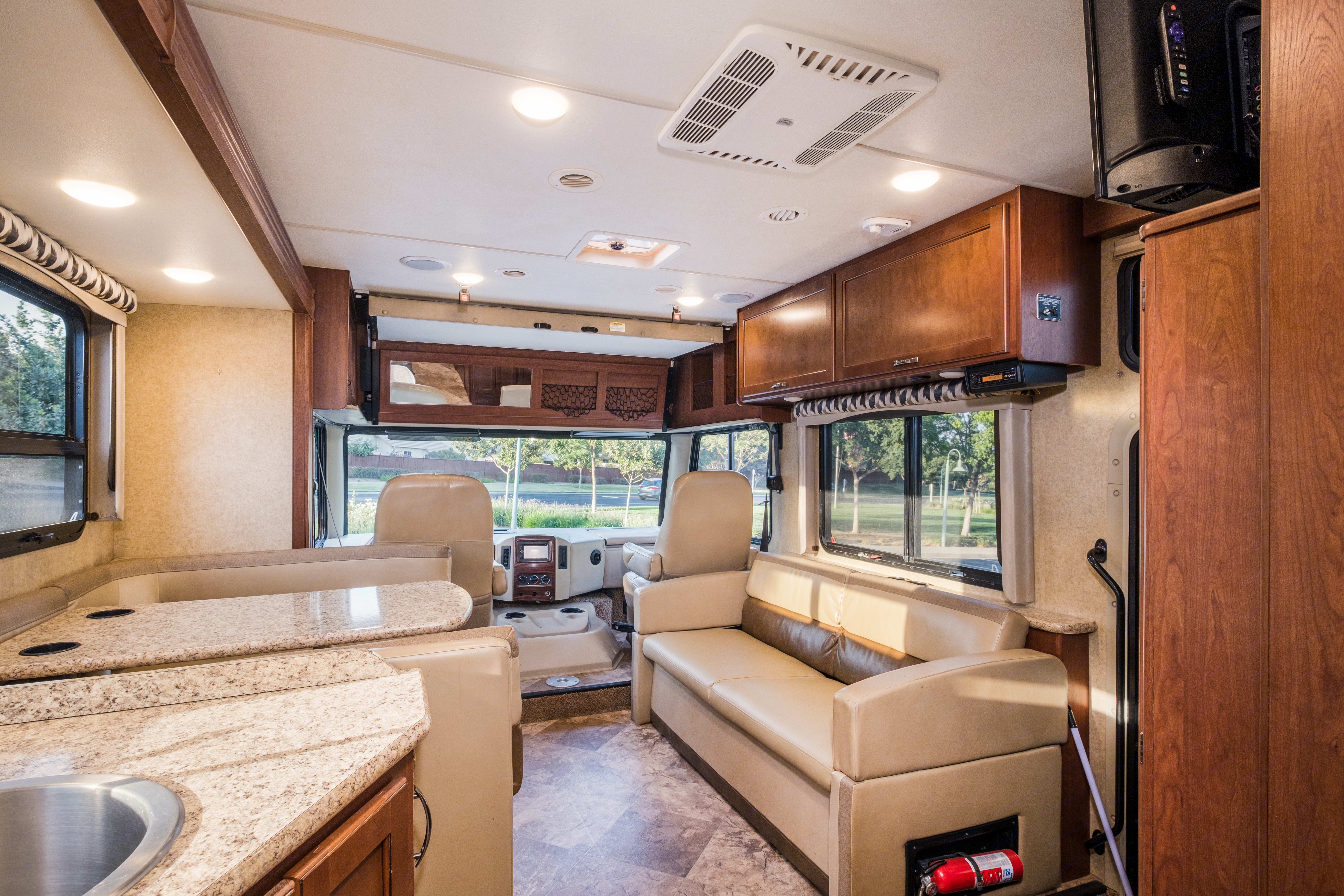 Table and couch fold into a bed. Thor Motor Coach A.C.E 2017