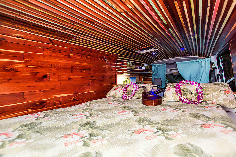 Vintage redwood recycled wood ceiling from original Hawaiian plantation home hand hewed by owner Joseph. Ford Transit 2016