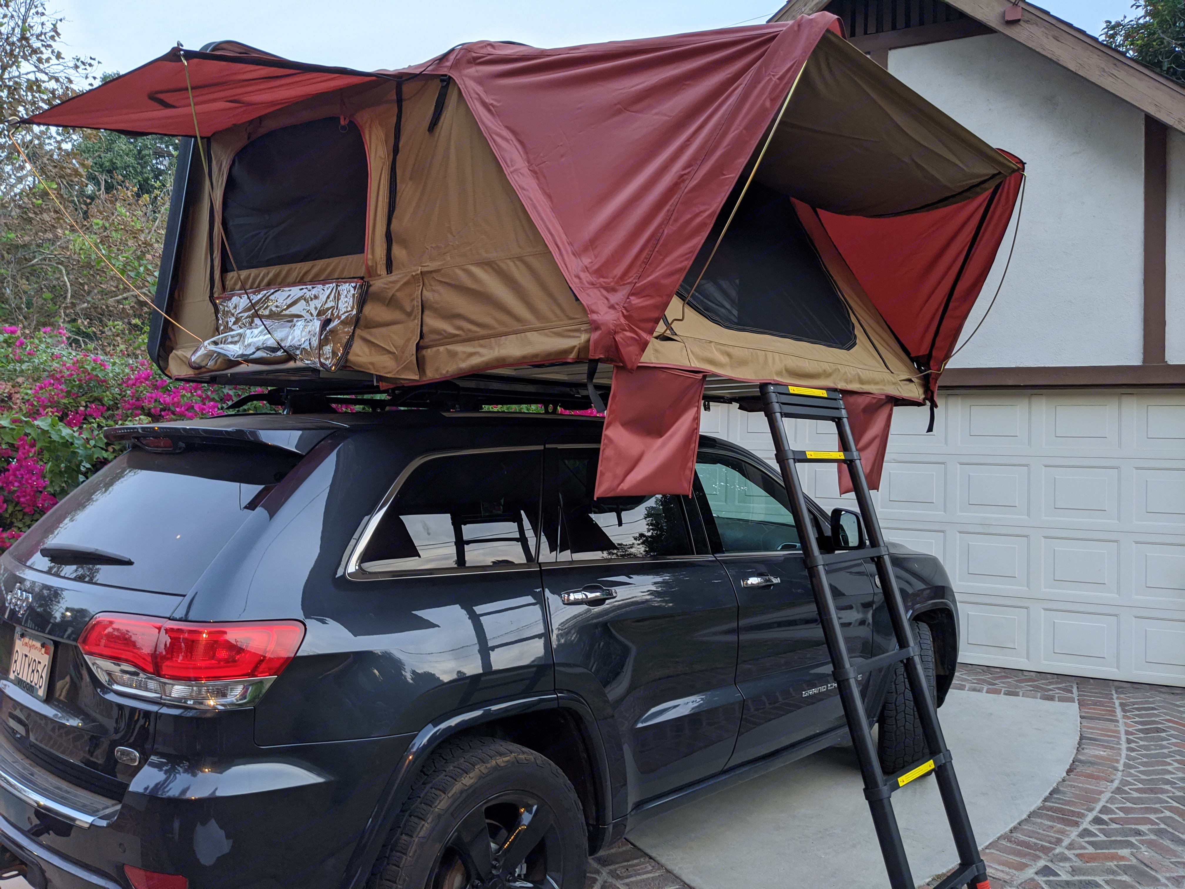 2 adults and 1 child or 1 adult and 2 children can sleep comfortably.. Jeep Grand Cherokee 2015