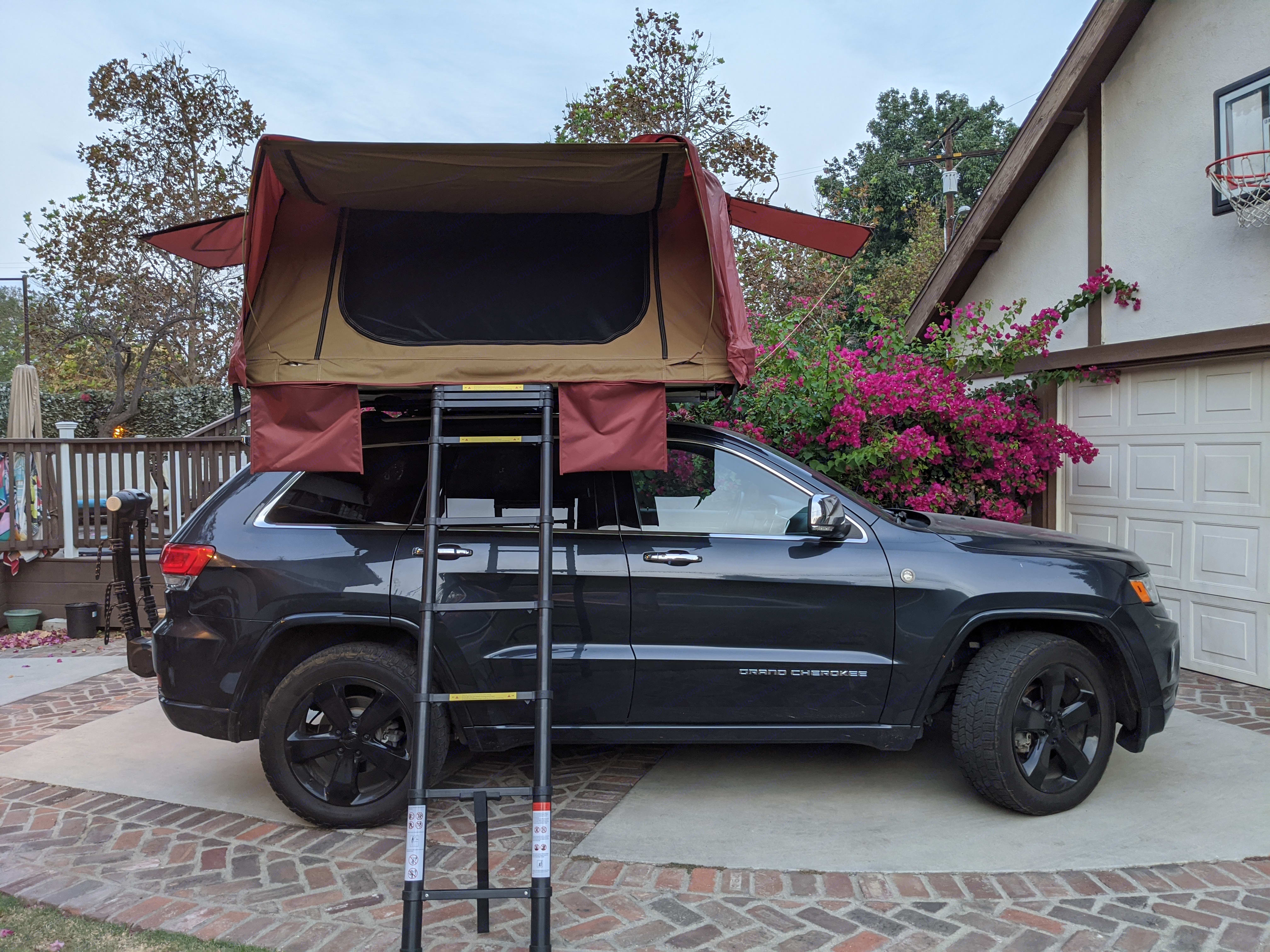 When I go with my wife and kids the kids sleep in the back of the car and we sleep in the tent :). Jeep Grand Cherokee 2015