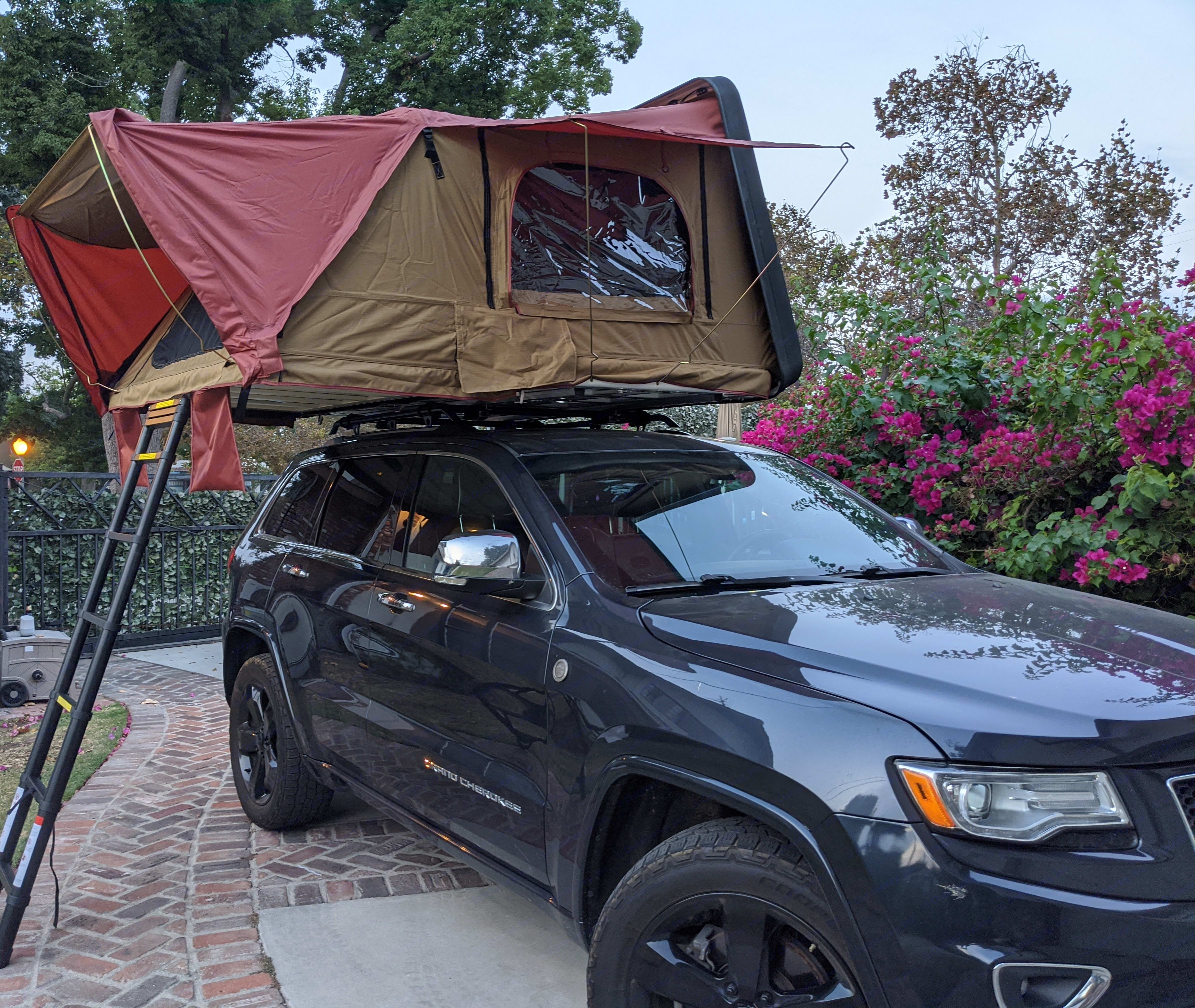 Roof top tent opens to a king size sleeping area. Also includes a full optional annex that can be attached. Jeep Grand Cherokee 2015