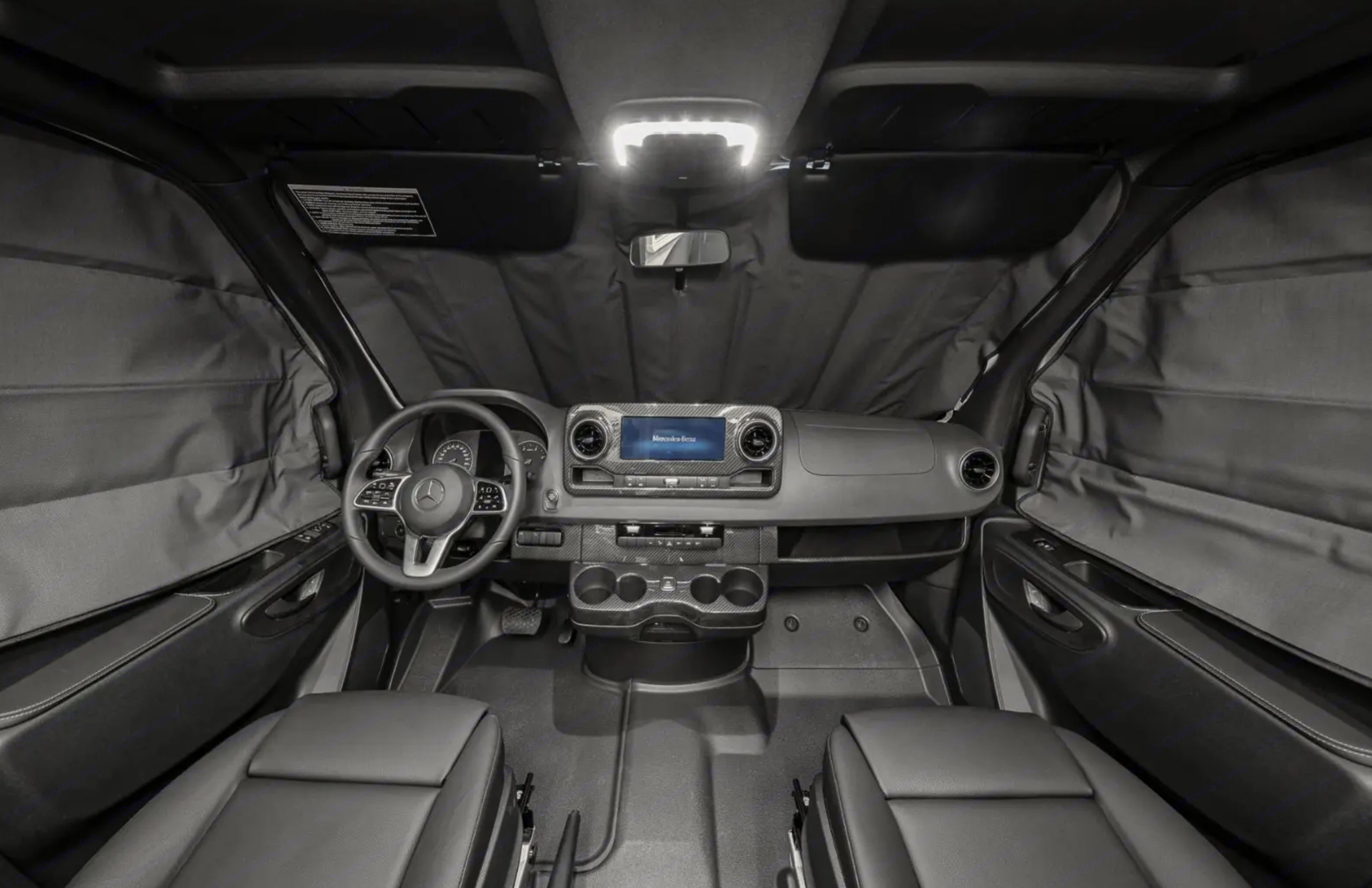 The cockpit; the Revel comes with privacy covers for the windshield and front windows.. Winnebago Revel 2020