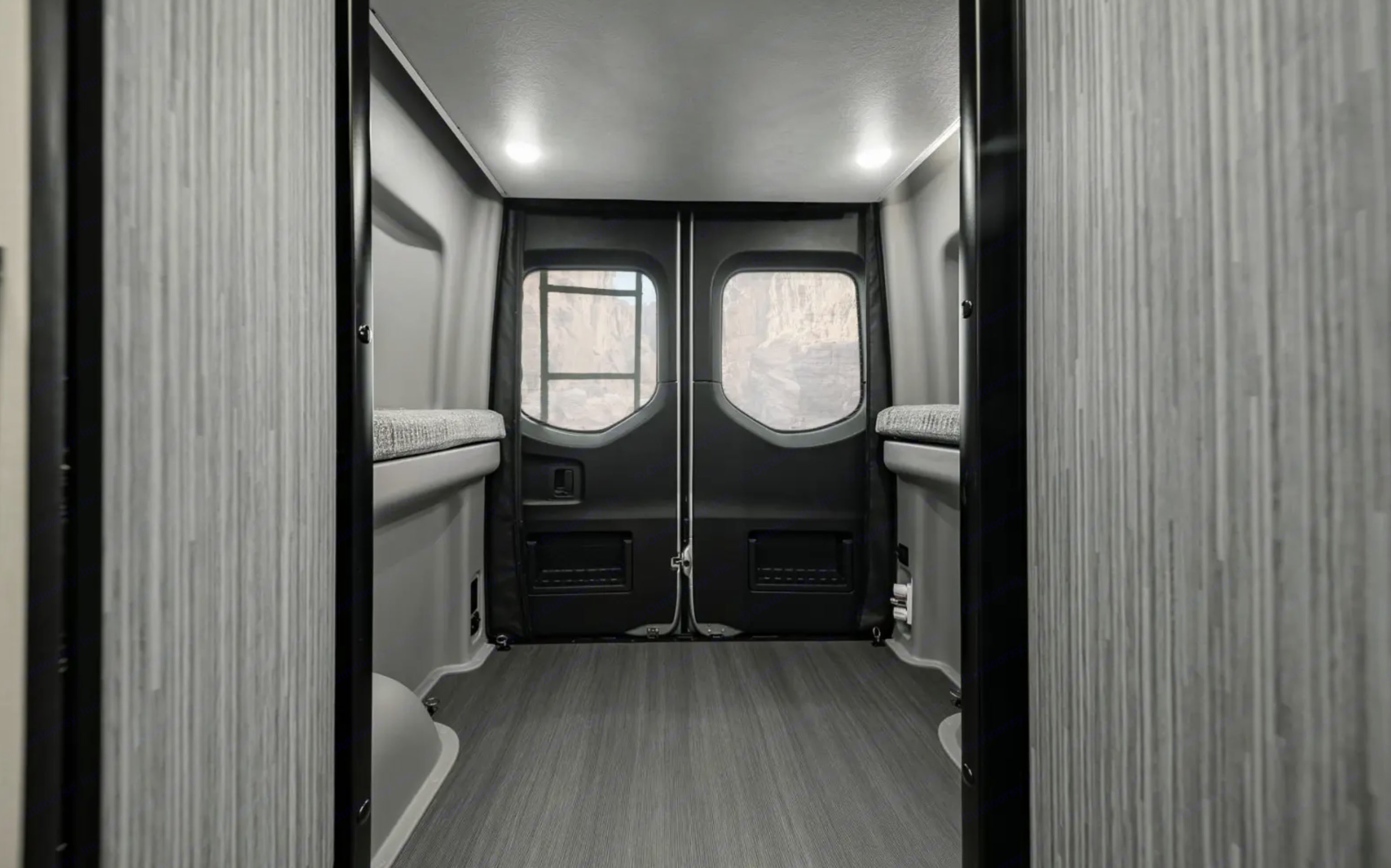 The lift bed can be raised for additional storage space.. Winnebago Revel 2020