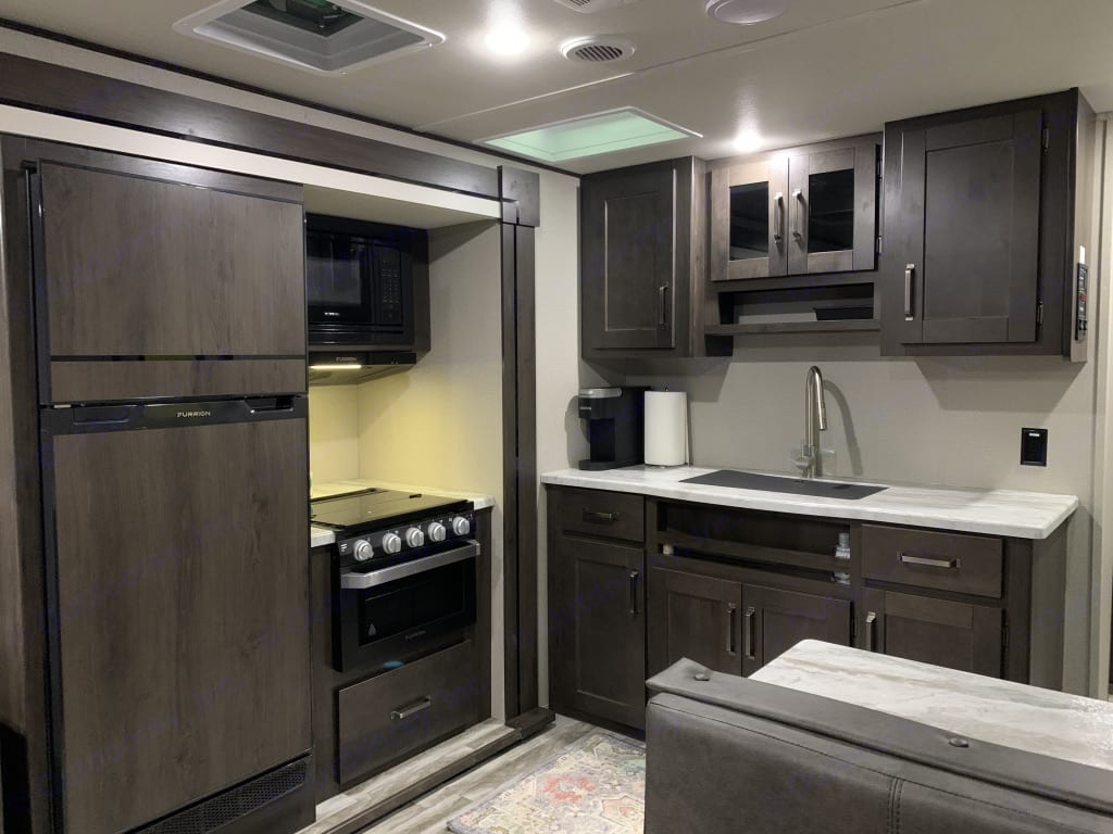 L-Shaped Kitchen with large, deep sink, tons of cabinet storage, Refrigerator, Freezer, Range, Oven, and Microwave!. Grand Design Other 2021