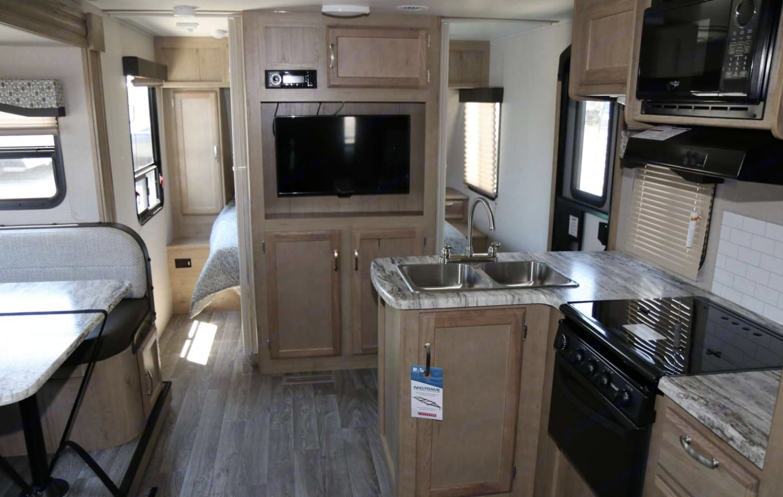 The dinette fits a family of four comfortably and the kitchen includes everything you need for a chef's delight.. Winnebago Micro Minnie 2020