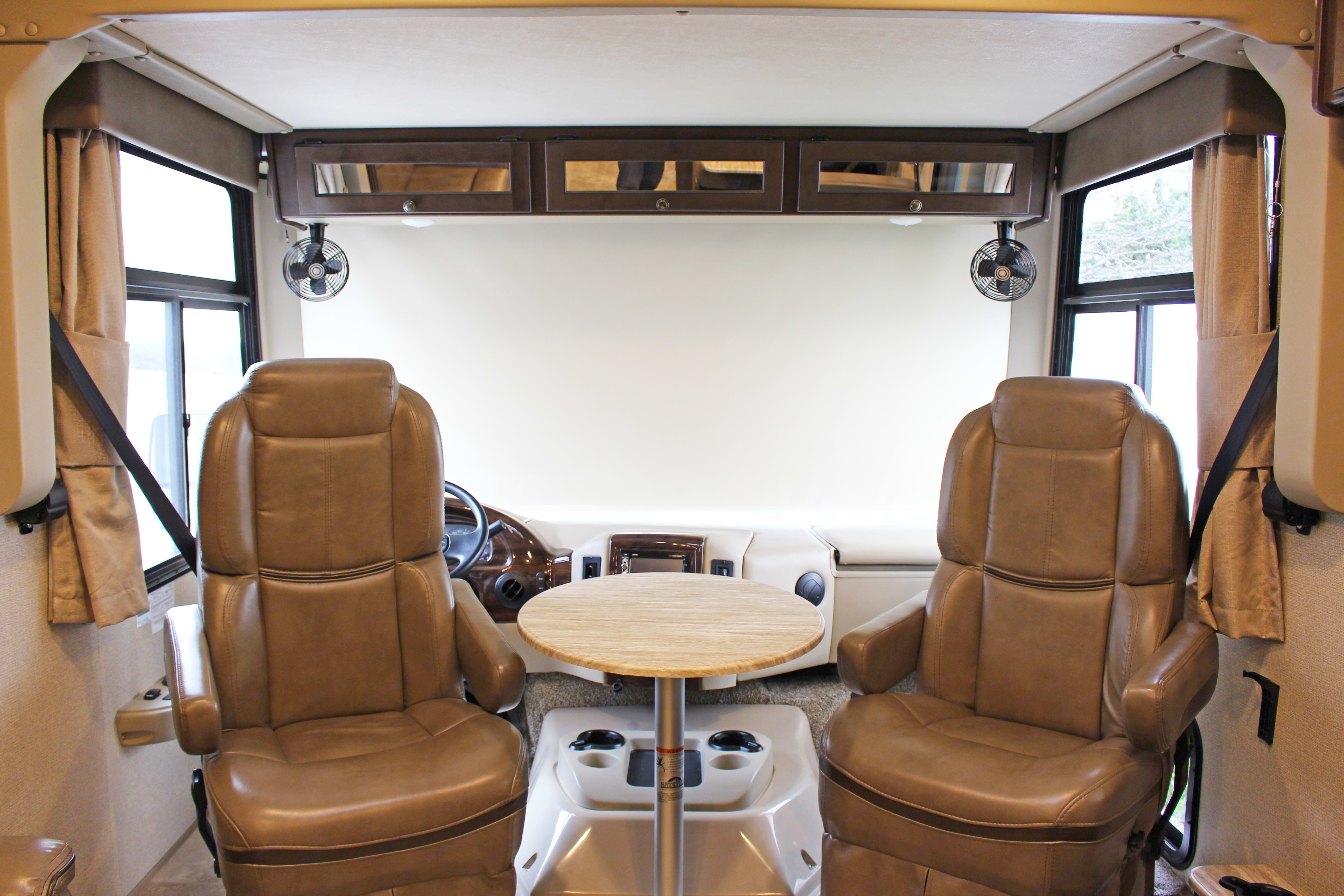Cockpit seat that can turn around and put a table between them. Thor Motor Coach Windsport 2018