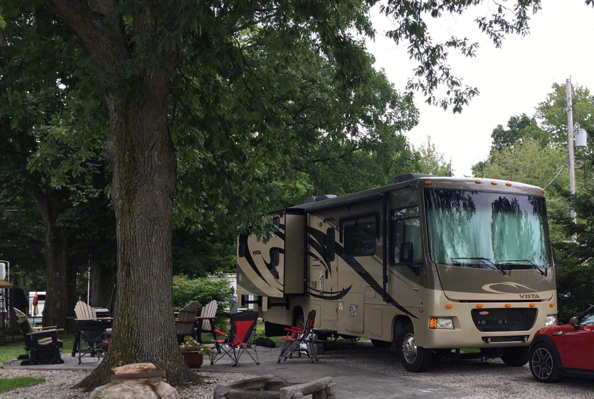 Rest and relaxation time at a campground, ahhhh!. Winnebago Vista 32K 2010
