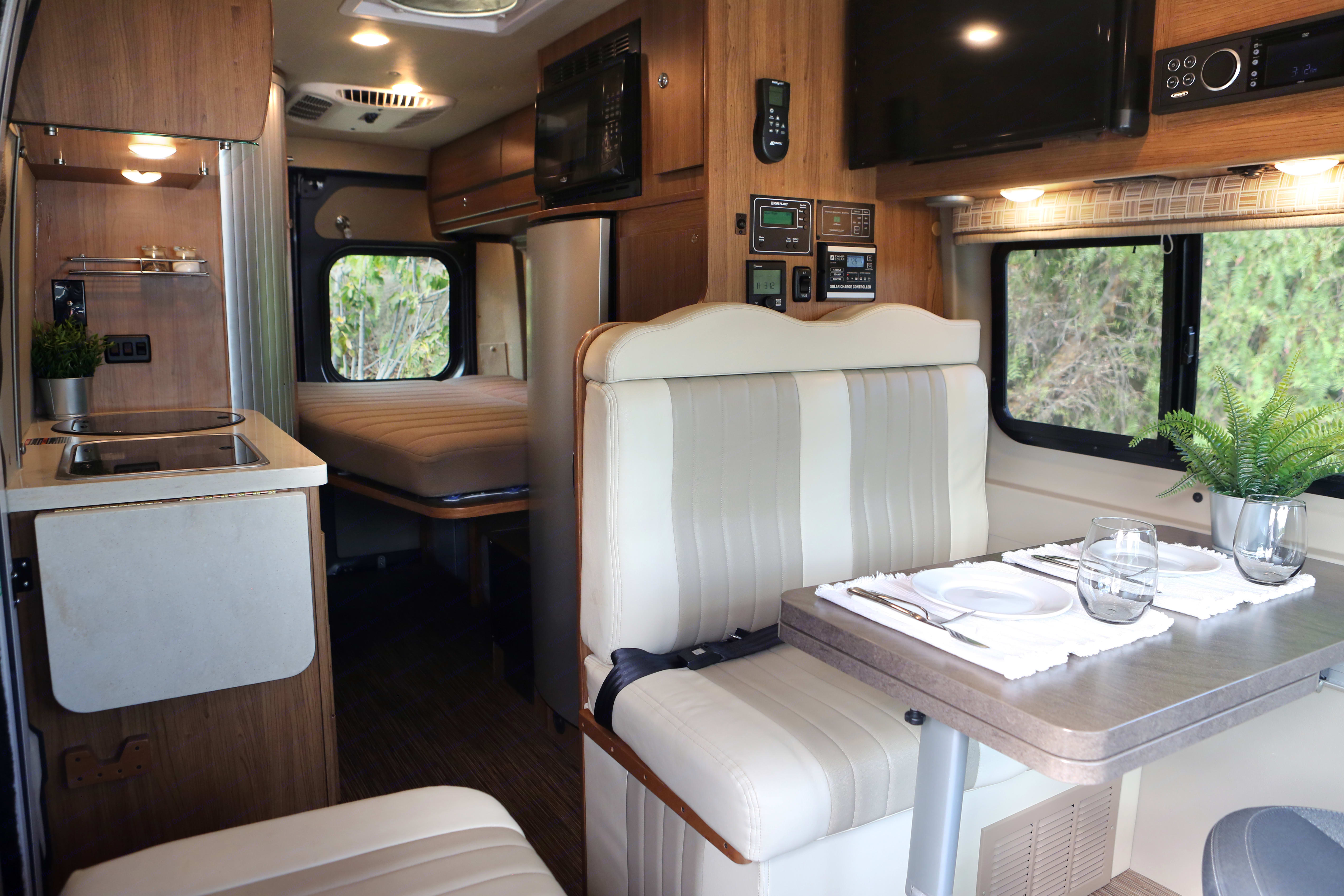 When it's time to turn in, enjoy the large corner bed, and set up the second berth in the front, or enjoy time on the Flat Screen TV.. Winnebago Travato 2018