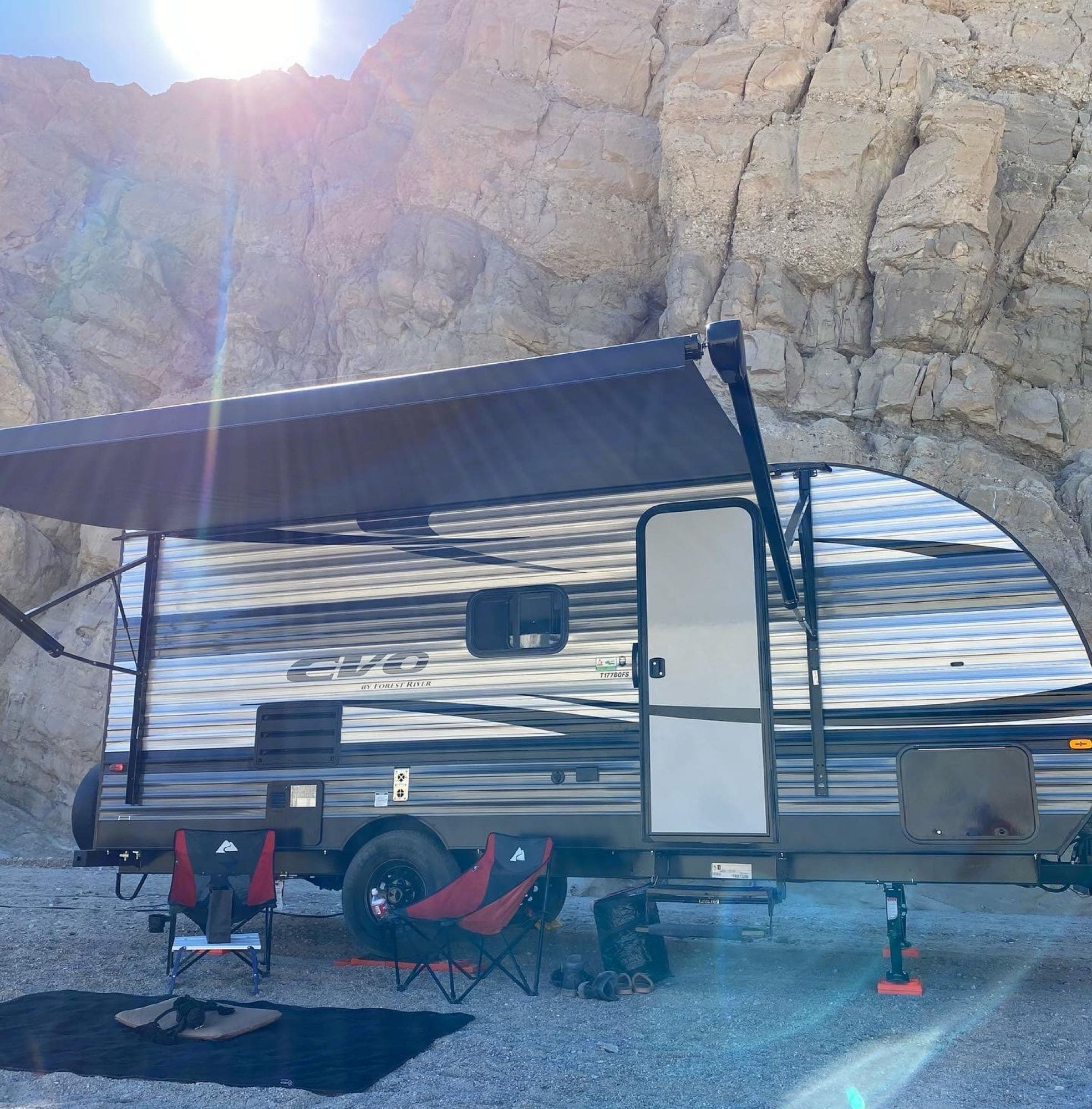 camp set up with awning deployed. Forest River Evo 2021