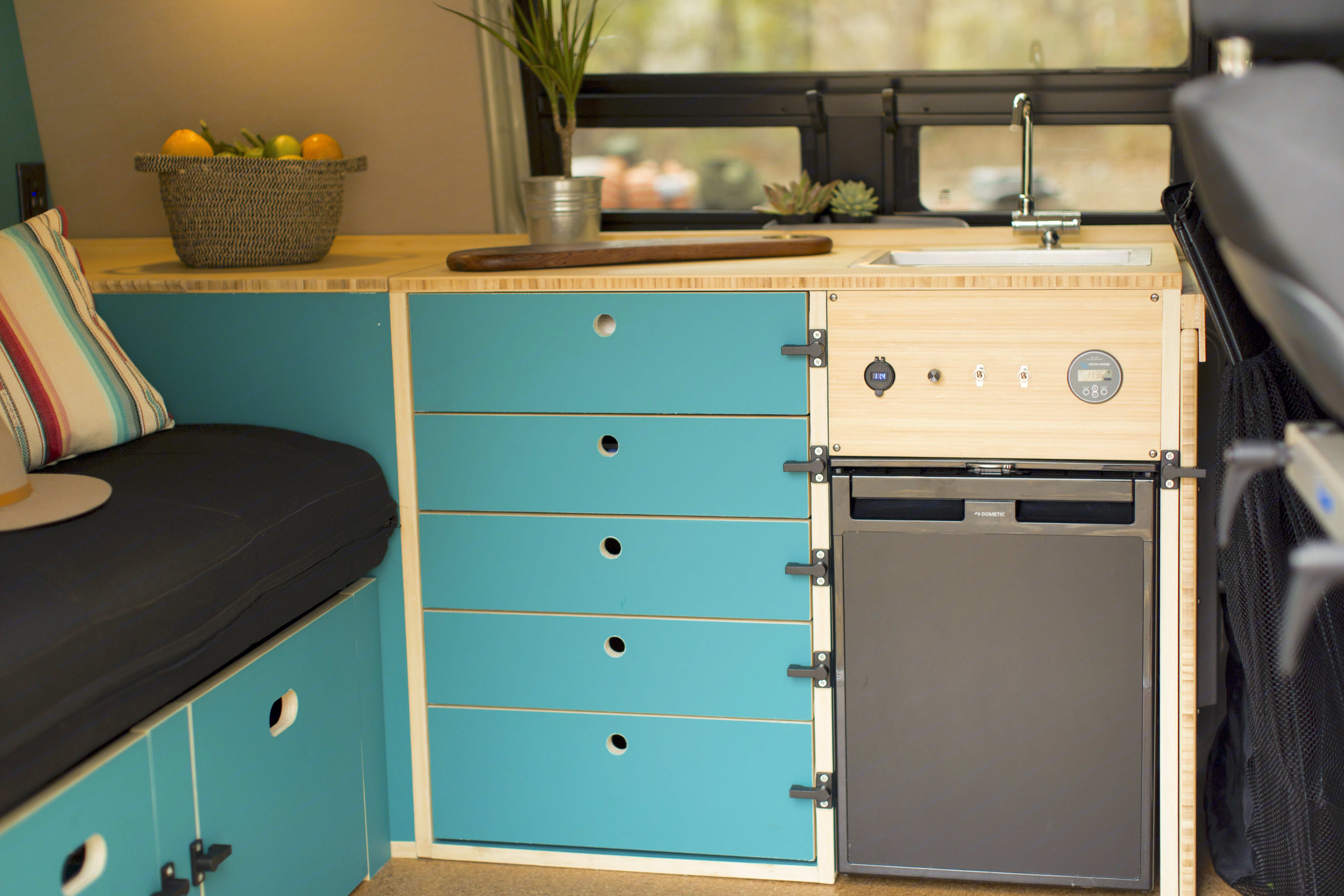 Our kitchen has a small sink, fridge and plenty of drawer and counter space to prep your finest campsite creations.. Mercedes-Benz Metris Pop-Top 2020