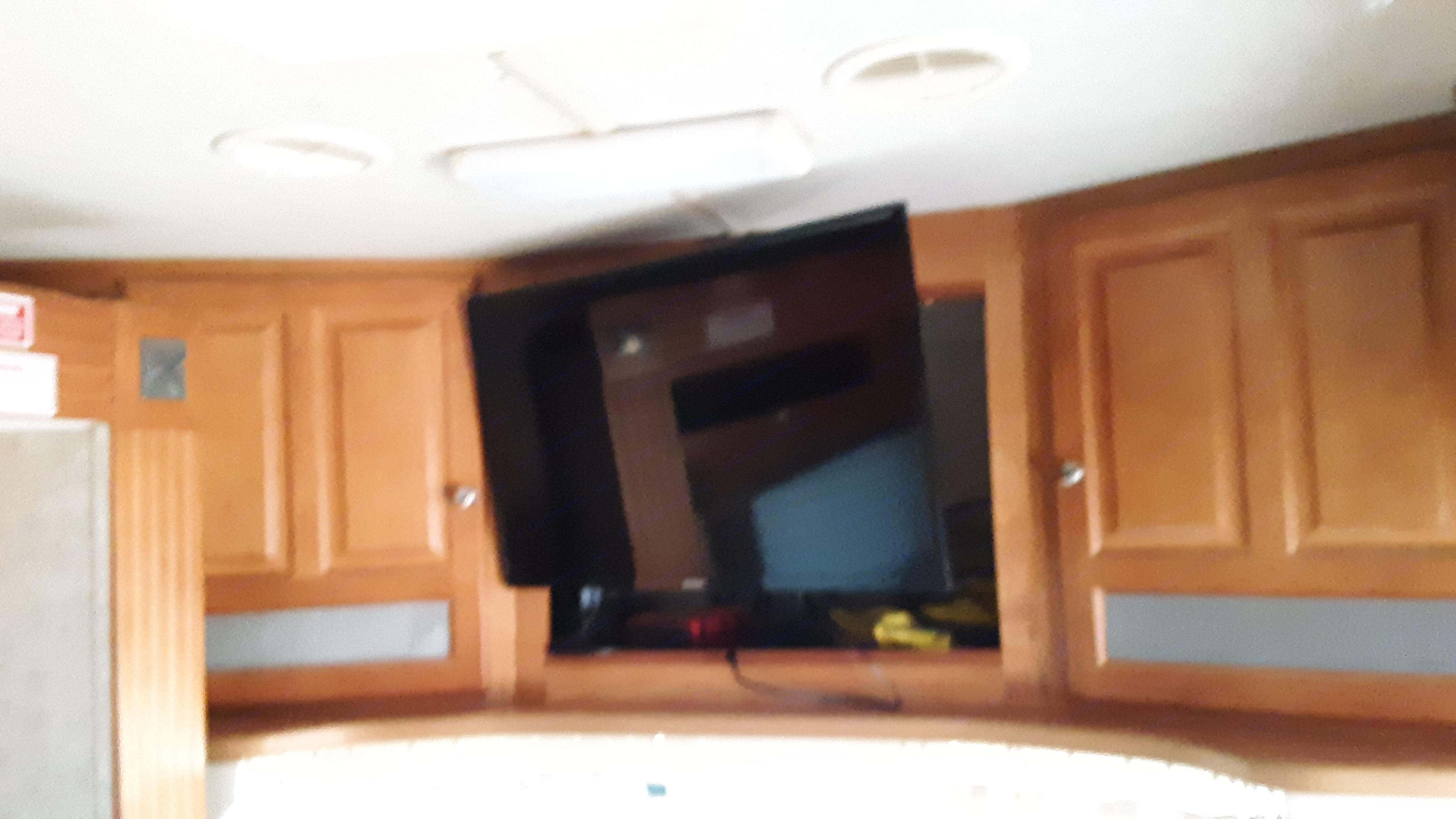 Flat screen TV with DVD player and satellite TV hookup for DirecTV as long as you can see the sky you can have cable TV. Gulf Stream B Touring Cruiser 2005