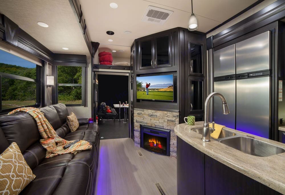 Large reclining couch with TV, and fireplace.. Dutchmen Voltage 2017