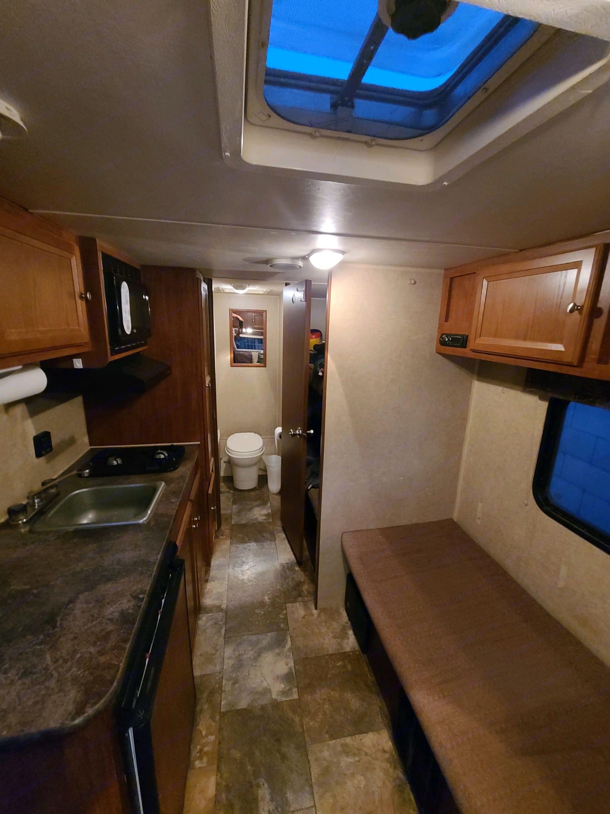 couch, radio, bunks, kitchen, bathroom. Jayco Jay Flight Swift 2014