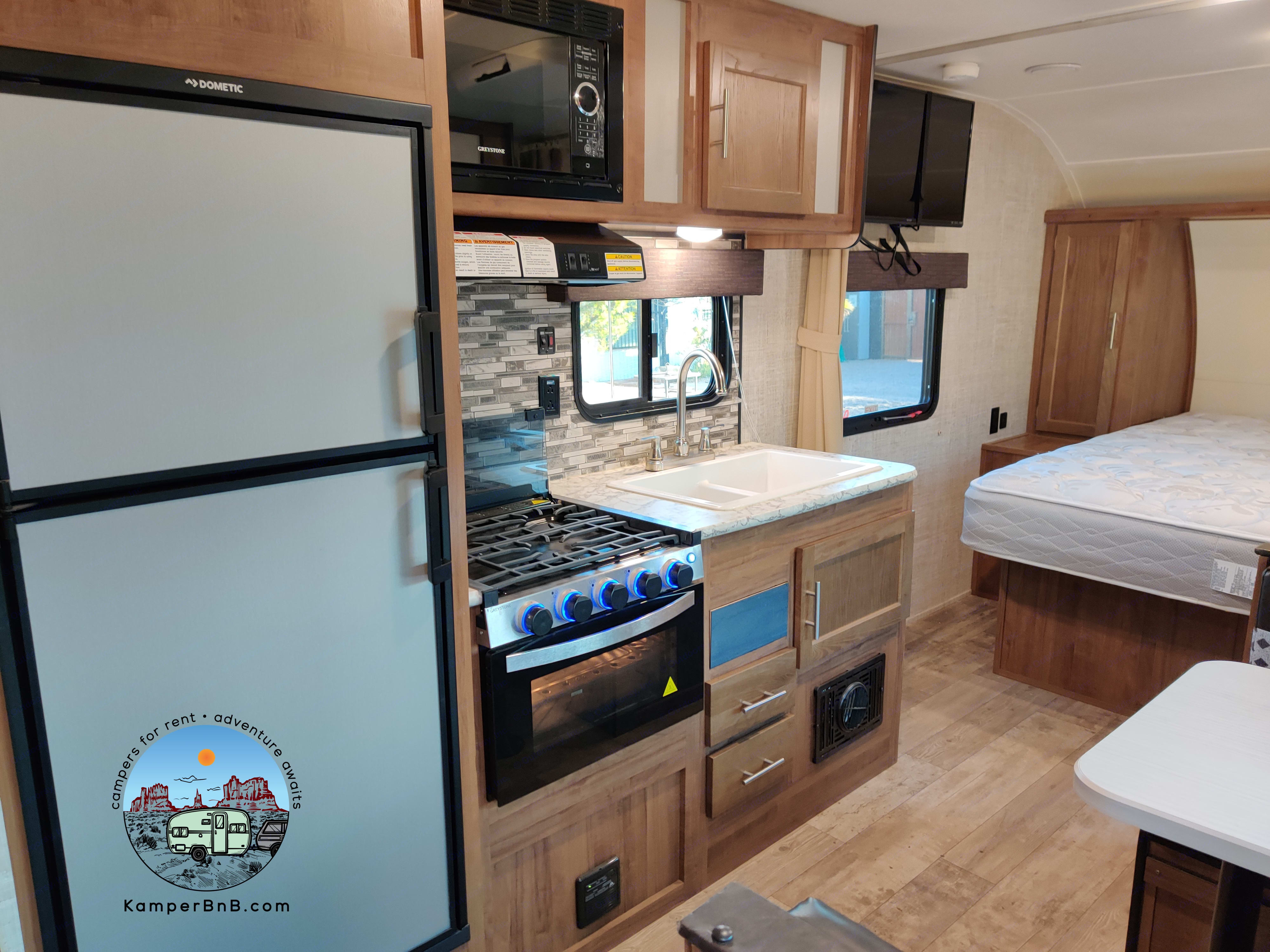A large kitchen greets you as you enter the trailer. Gulf Stream Amerilite 218MB 2020