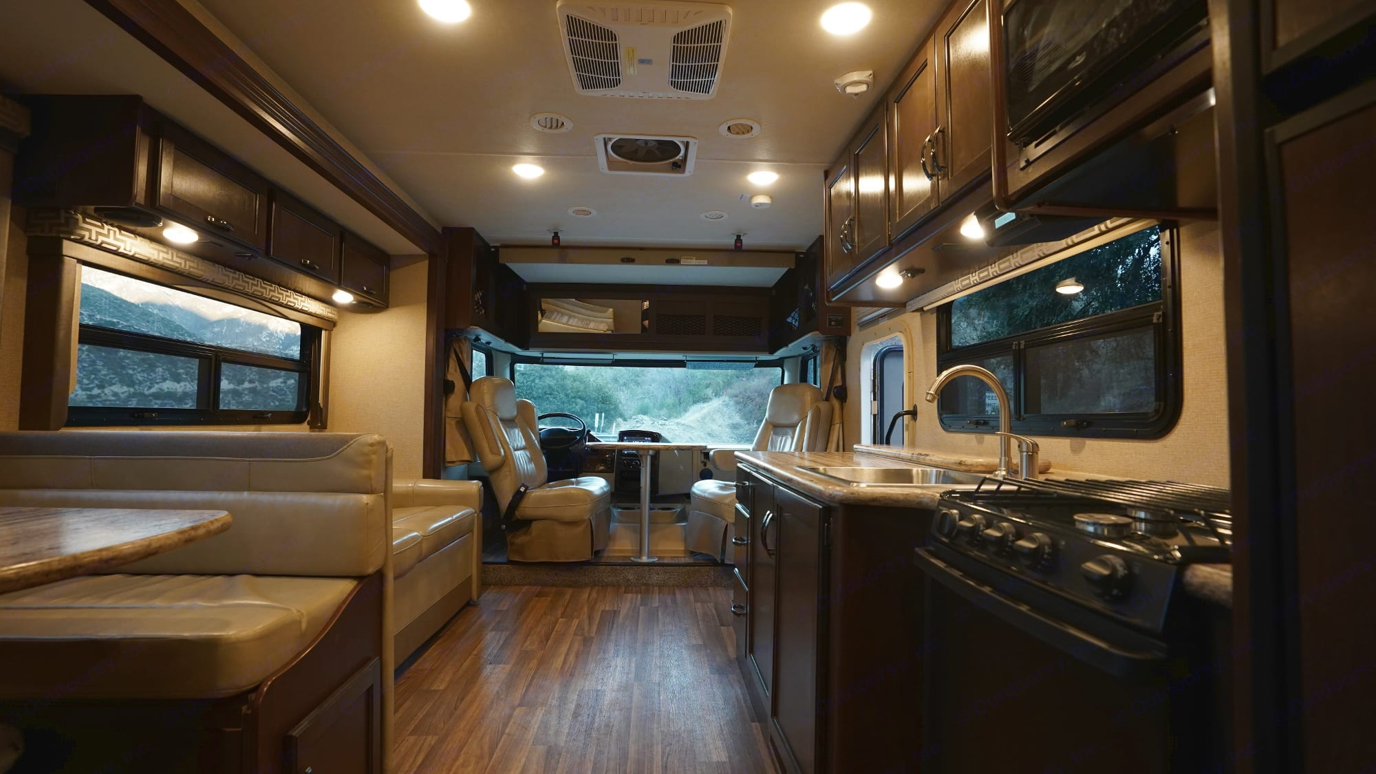 Open floor plan. Driver and Passenger chairs swivel to allow for extra seating. Table is removable while driving.. Thor Motor Coach A.C.E 2020