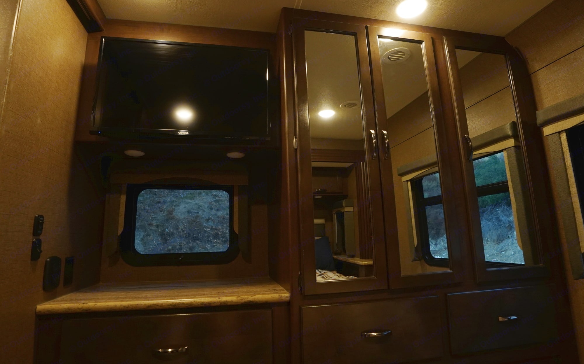 Lots of storage in the bedroom along with a TV and DVD player.. Thor Motor Coach A.C.E 2020