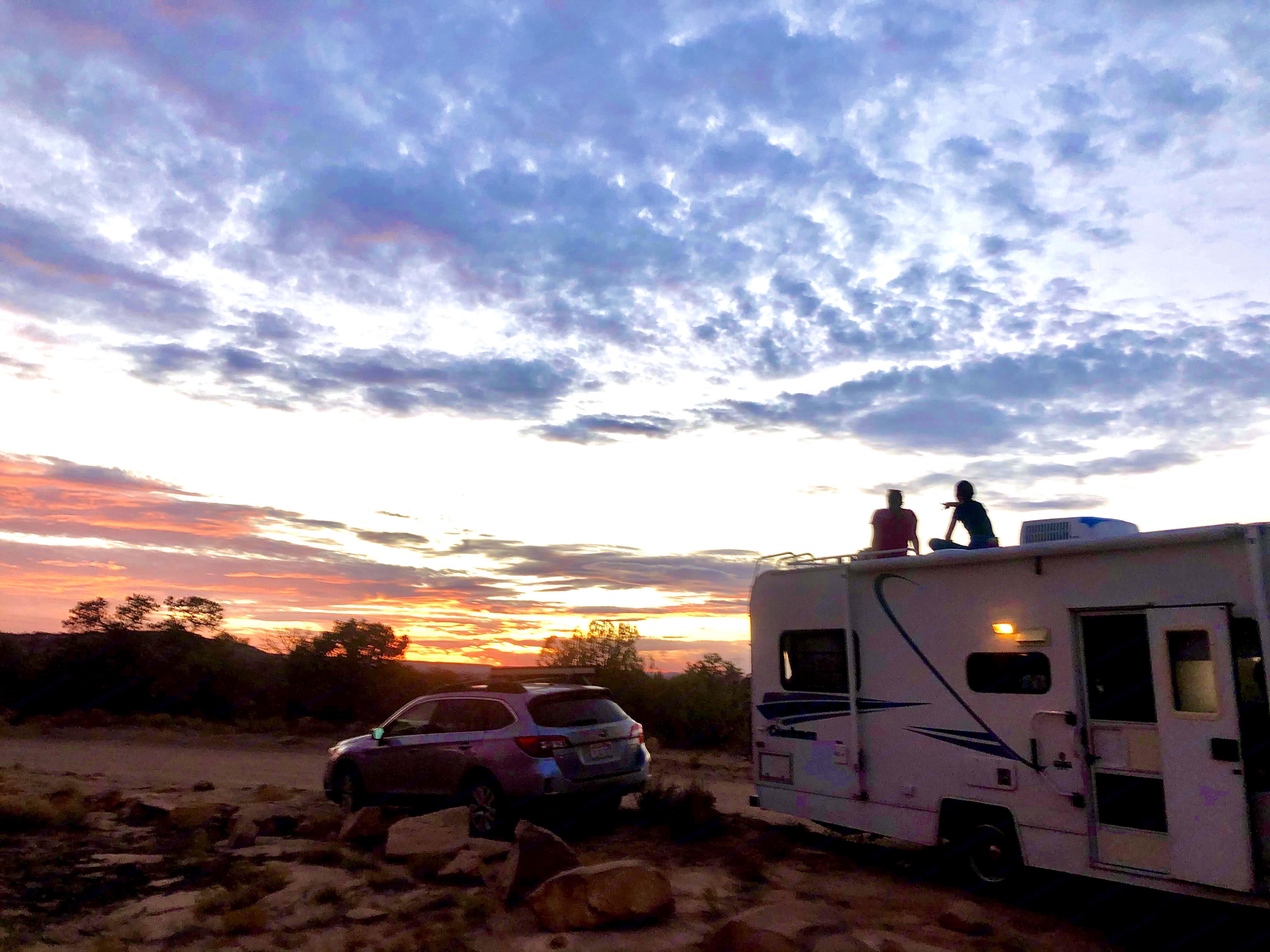 Watching the sun set near Canyonlands . Coachmen Catalina 1996