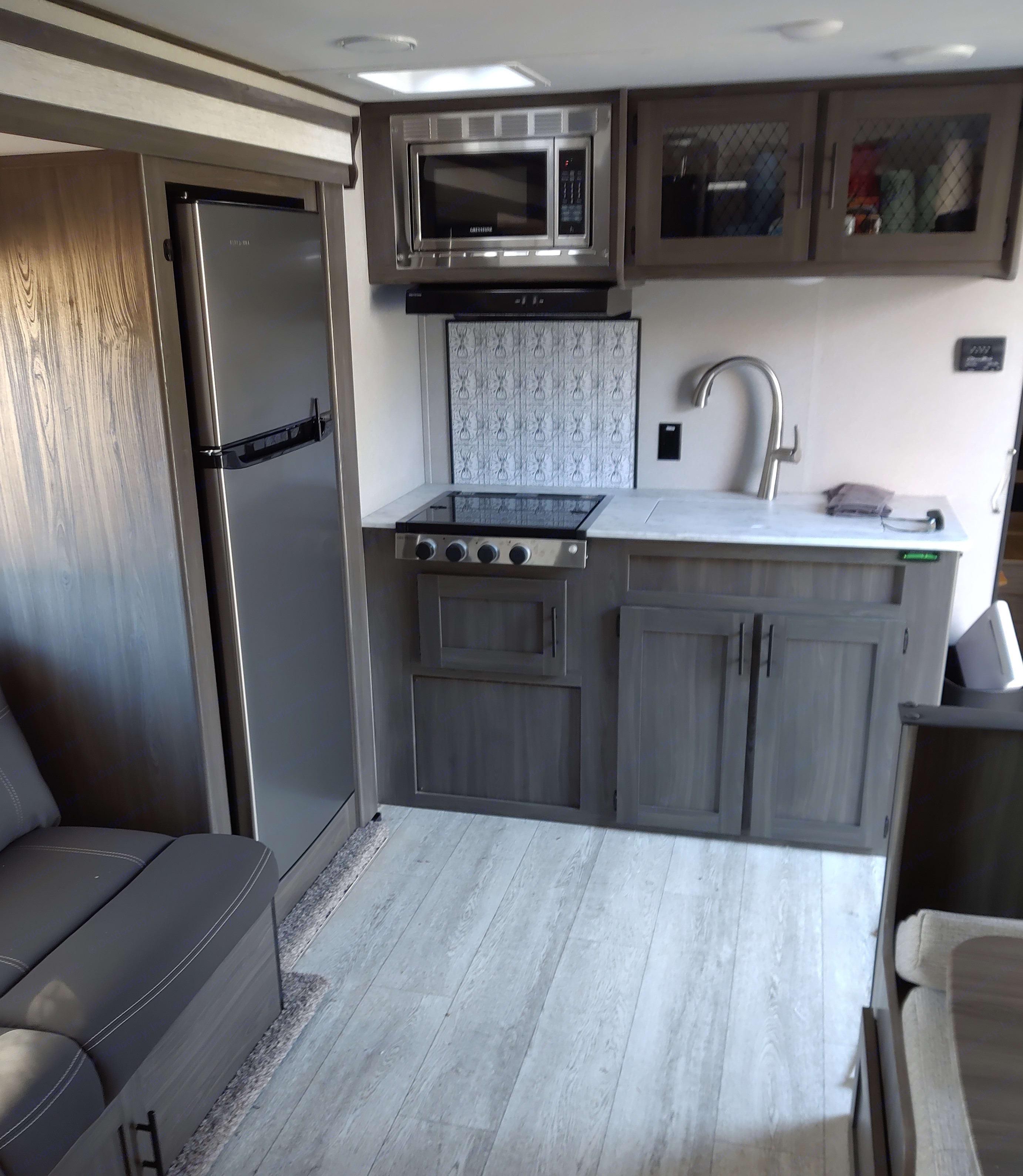 3-burner stove; microwave; Kuerig coffee machine; sink; large refrigerator. Shasta Oasis 2021