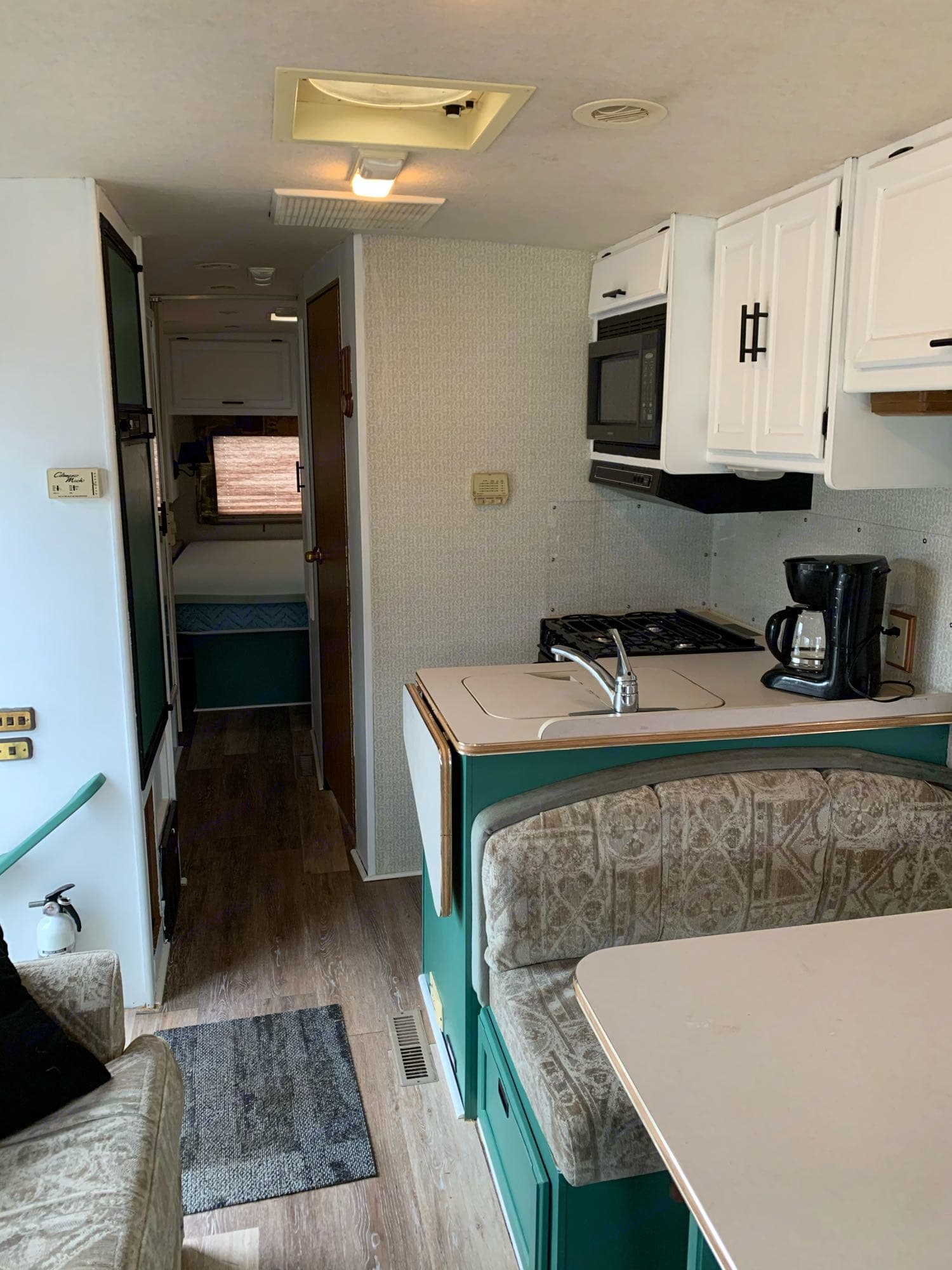 kitchen comes equipped with microwave, propane powered stove and oven, sink and coffee pot. Winnebago Brave 1998
