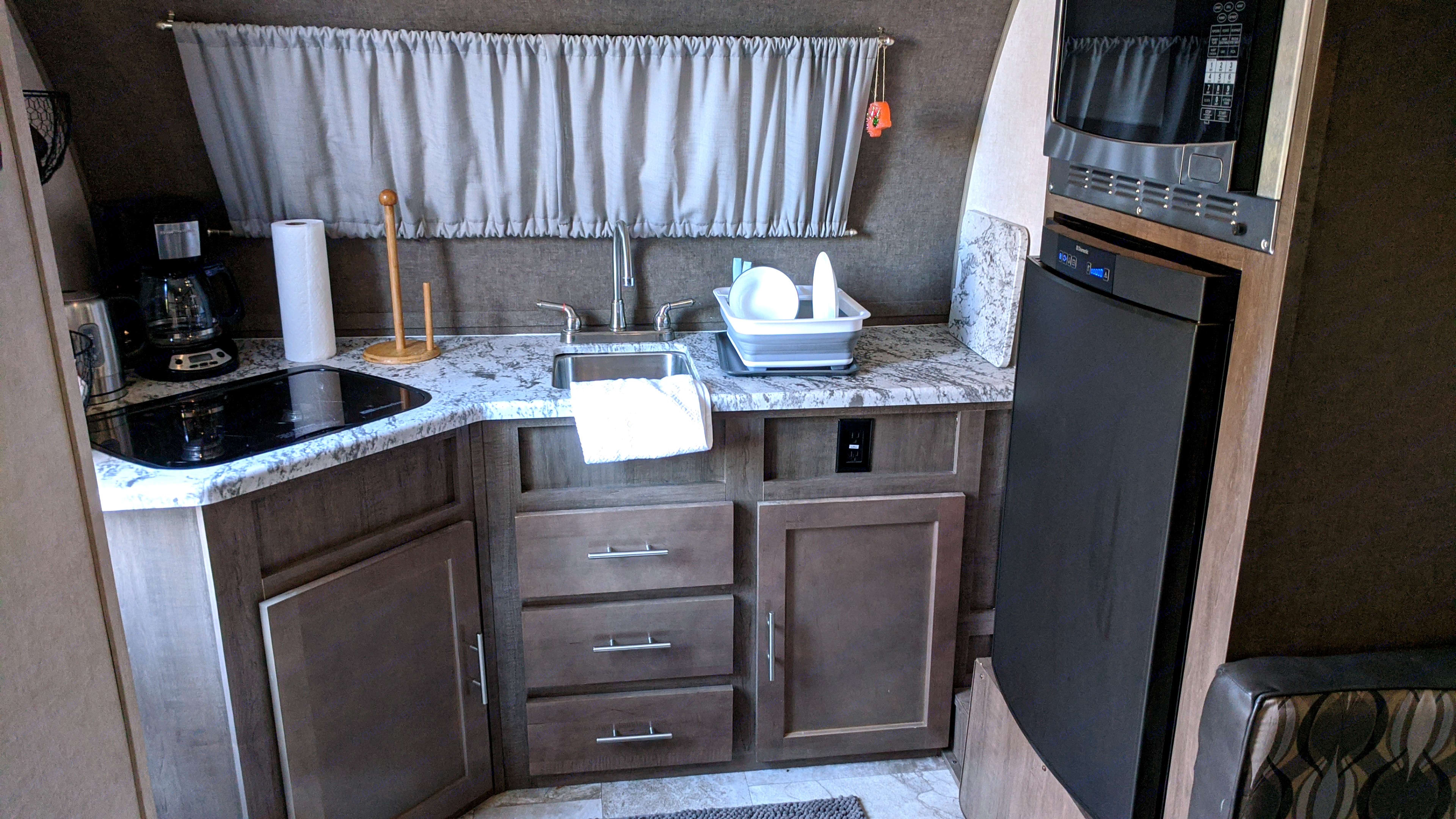 We love this kitchen, plenty of counterspace and storage. Forest River R-Pod 2019