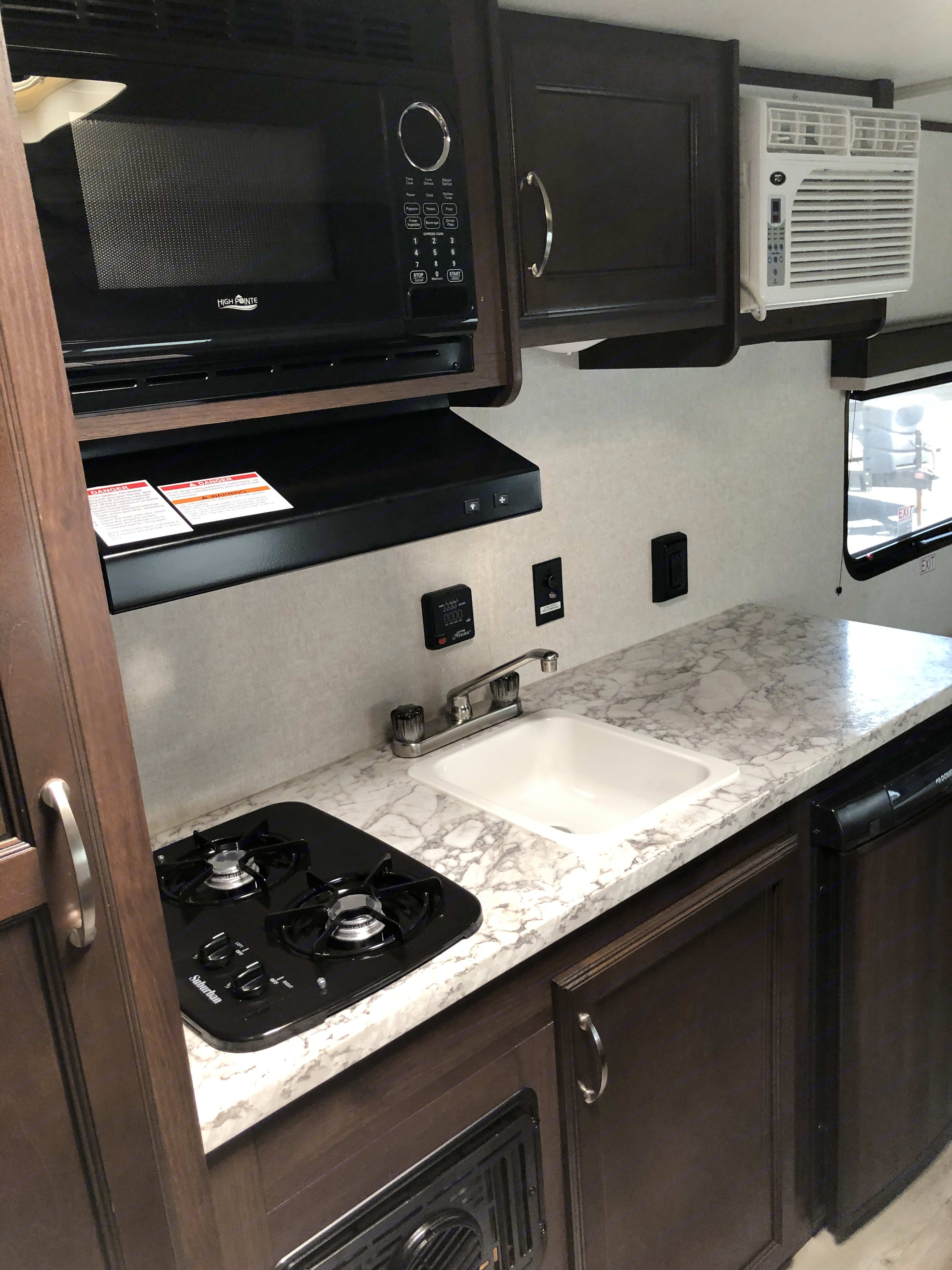 Rainy day? We got you covered with a full indoor kitchen!. Jayco Jay Flight 2018