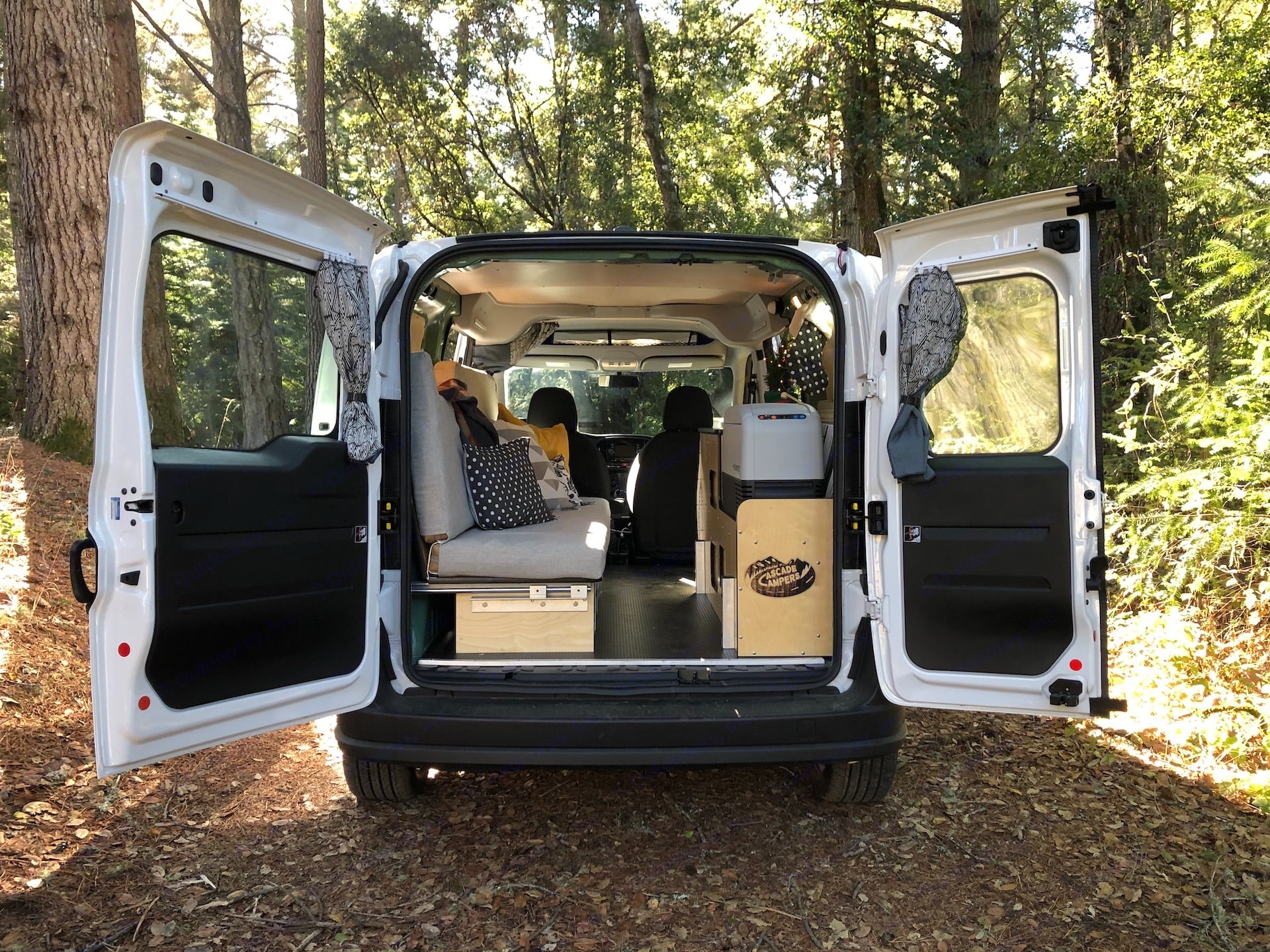 Bed folds into a bench during the day.  Under the bench there are 5 bins that store kitchen essentials with some space left for your personal items.  . Ram ProMaster City 2019