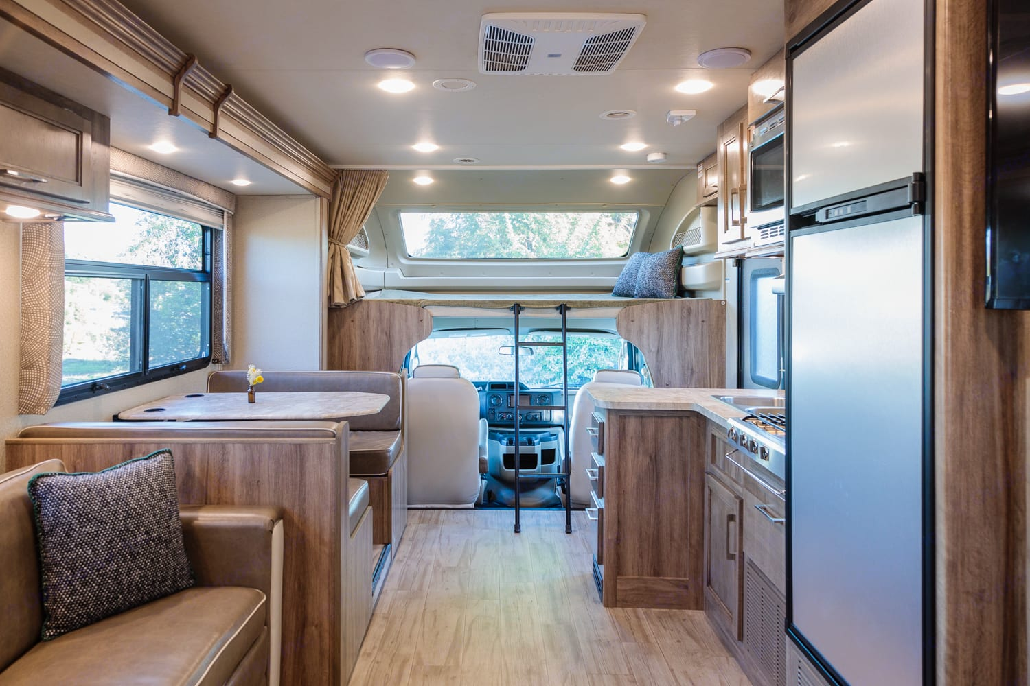 Spacious modern interior with one large slide out.. Entegra Coach Odyssey 25R 2019