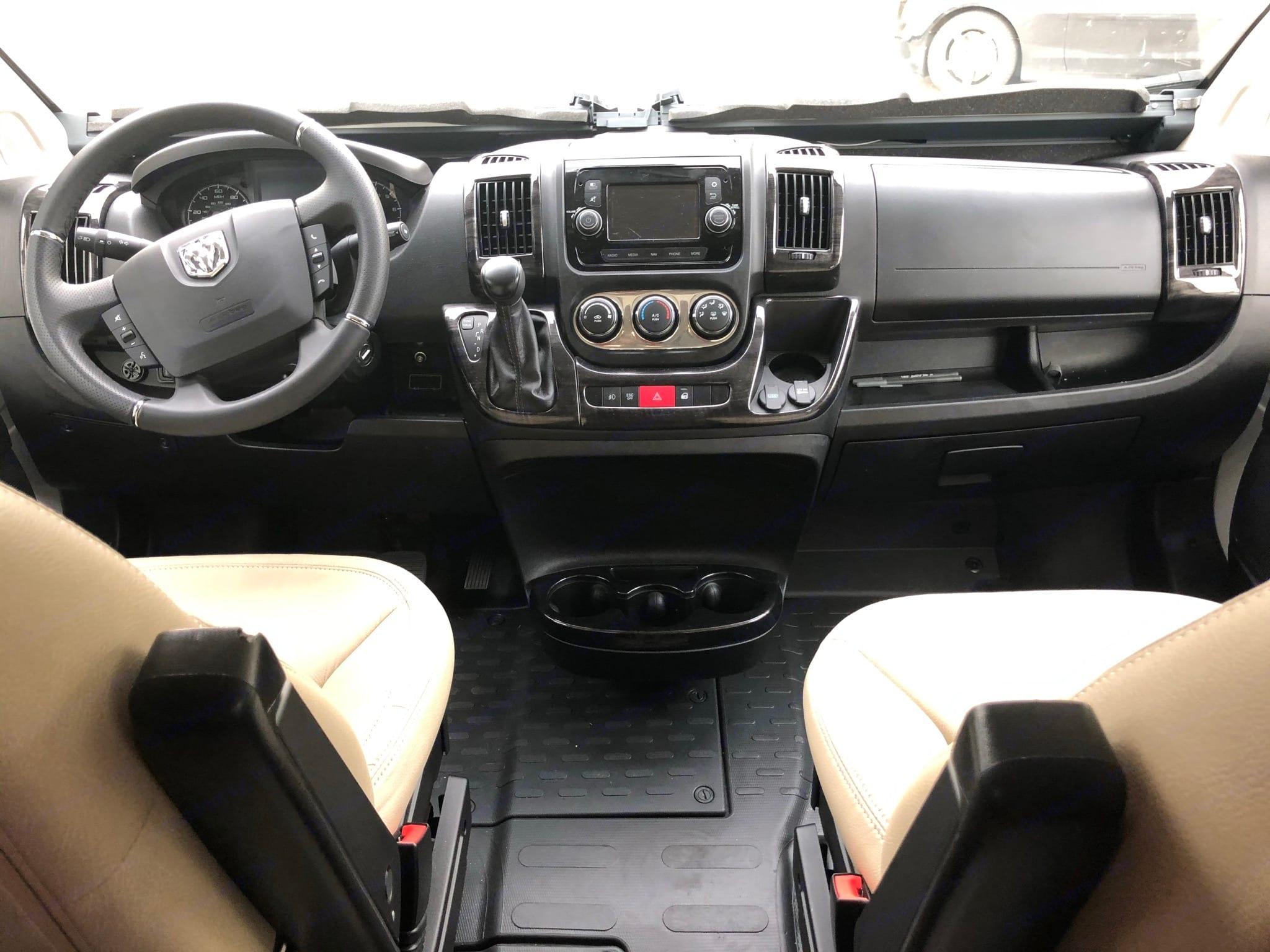 Overhead storage above driver and passenger seats. Winnebago Travato 2020