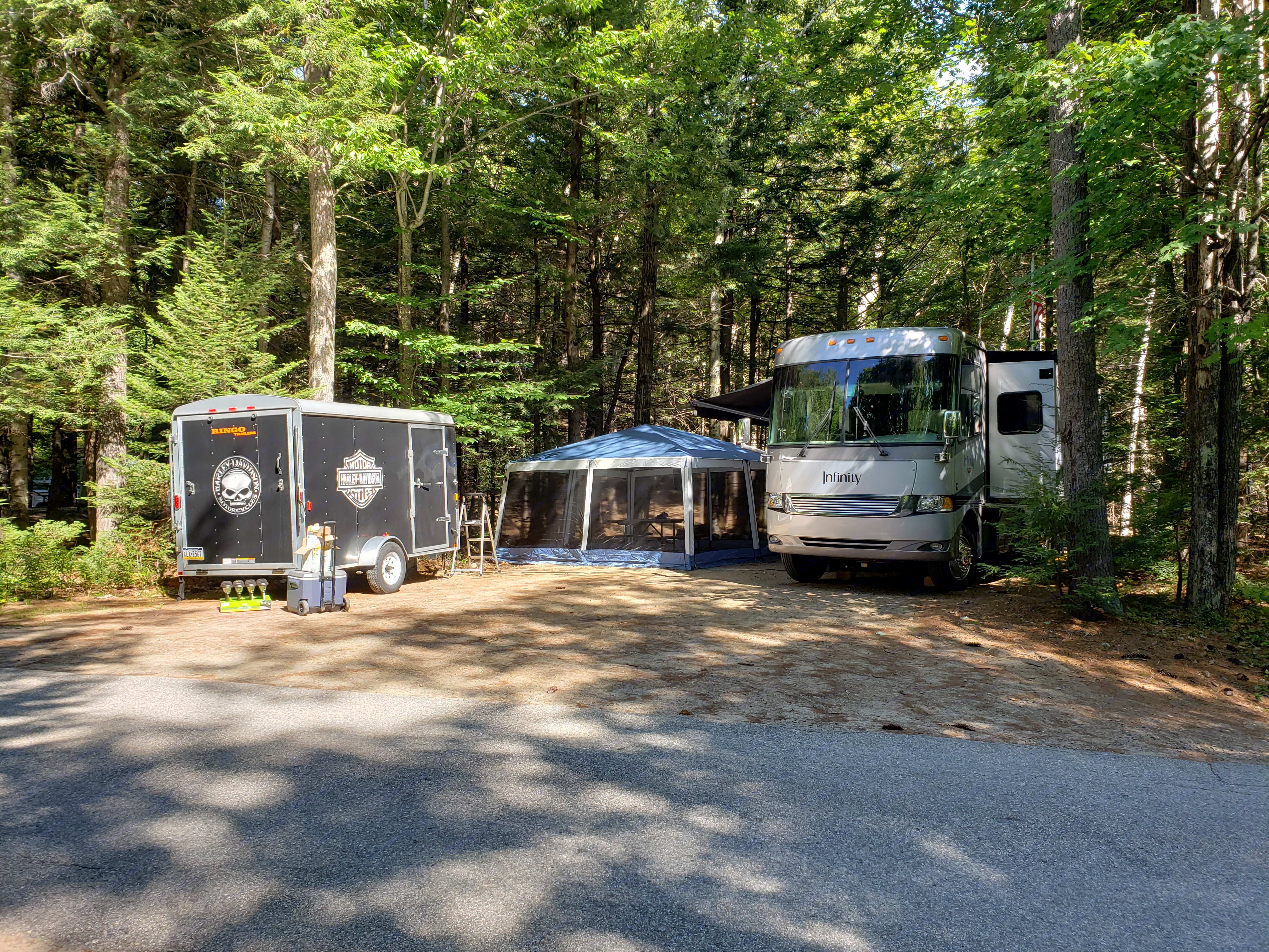 Site set up with Motorcycle trailer. Thor Motor Coach Four Winds Infinity 2005