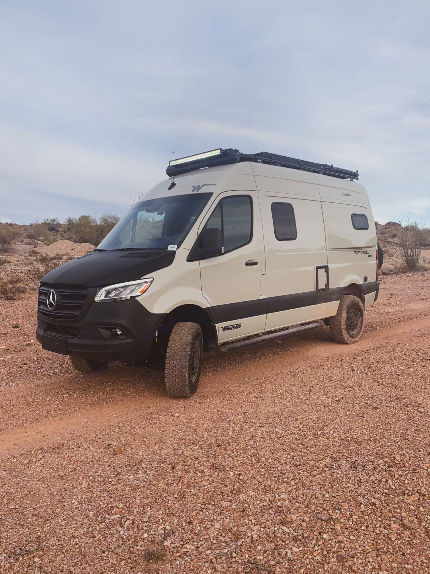 This photo was taken in the desert just outside of AZ. The front hood is a carbon fiber wrap to avoid scratches/dents from driving.. Winnebago Revel 2021