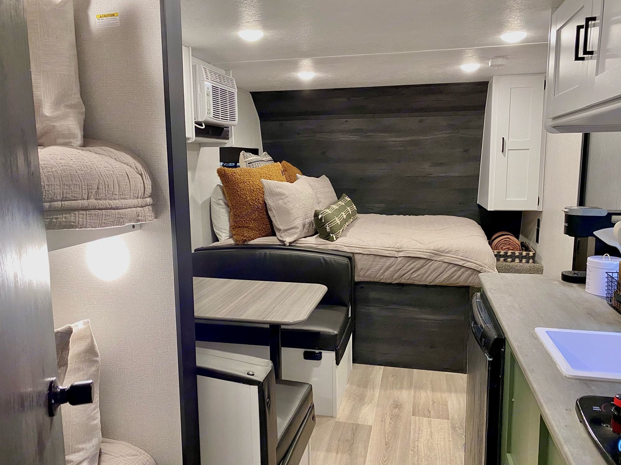 Queen Bed with 3 in. foam mattress topper and luxury linens.. Keystone Hideout 2021