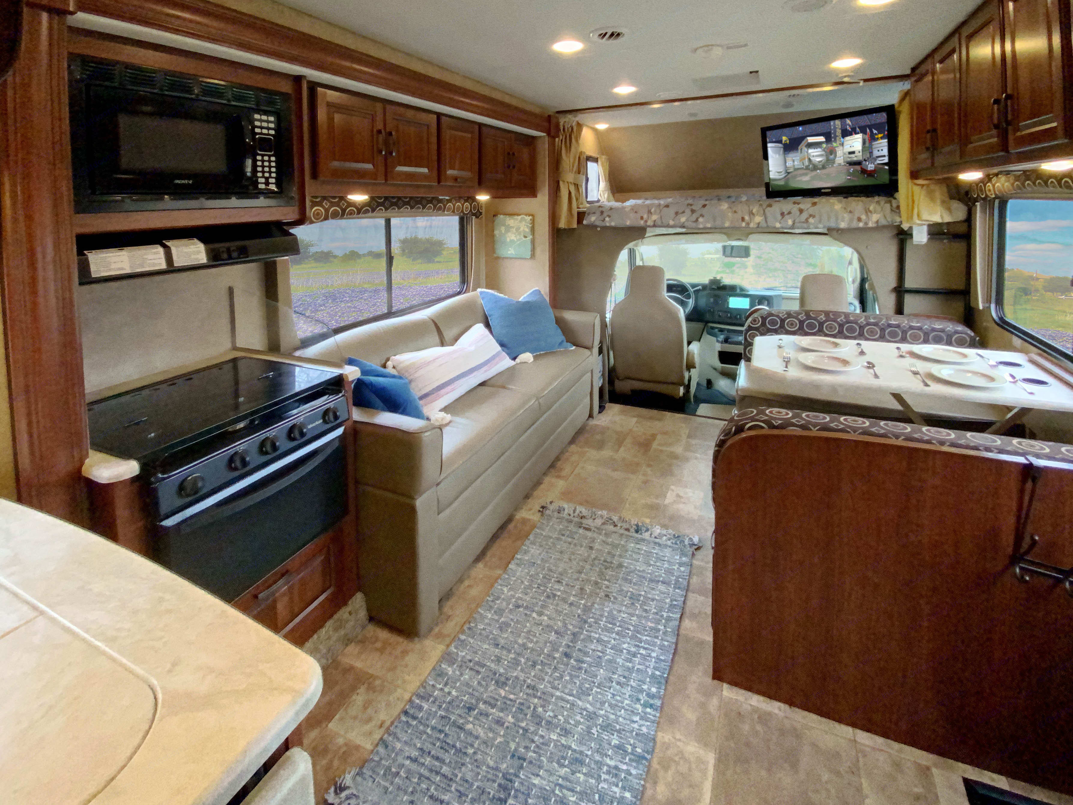 Large living area with jack-knife couch, king-size over-the-cab bed. Forest River Forester 2015
