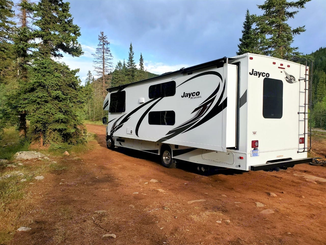 Full wall slide out provides extra space inside.. Jayco Redhawk 2021
