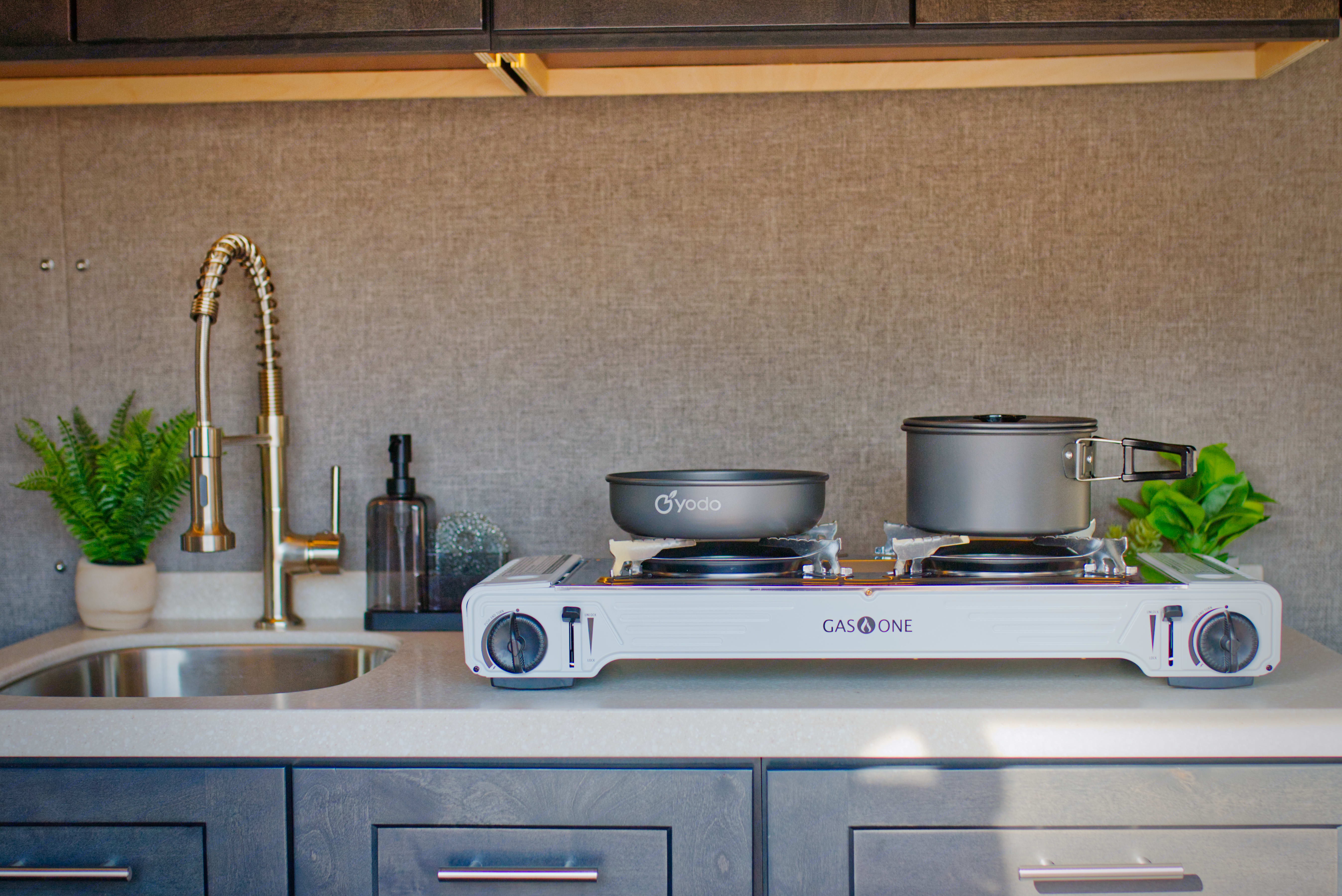 Take your camping food to the next level in our kitchenette stocked with all the essentials and a mini fridge!. Ford Transit 2020