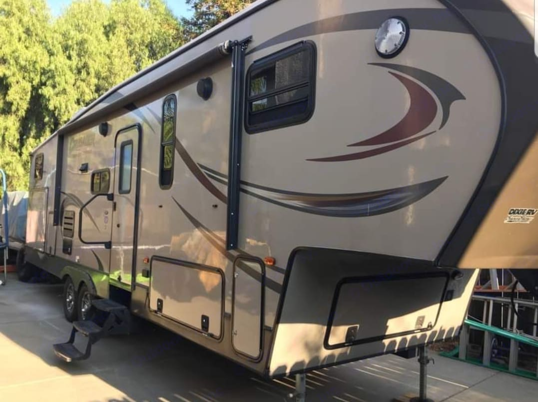 Door side with 3 steps and exterior speakers and awning. Also has side to side storage. . Forest River Crusader 2015