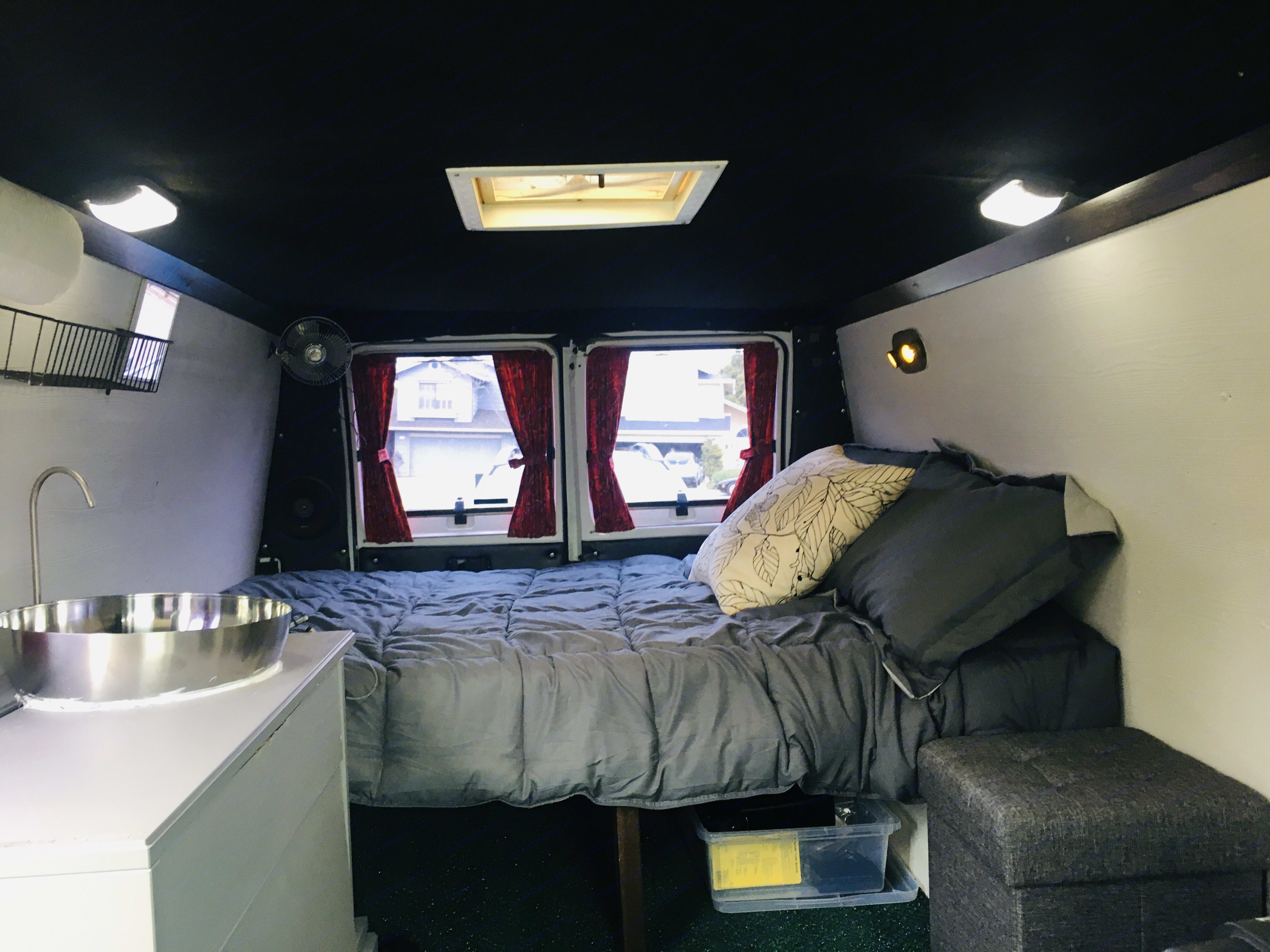 Cozy Bed (5'10 length), roof vent, fan, LED light, table and sink. USB at the foot of the bed. Lots of storage under the bed.. Dodge B2500 2001